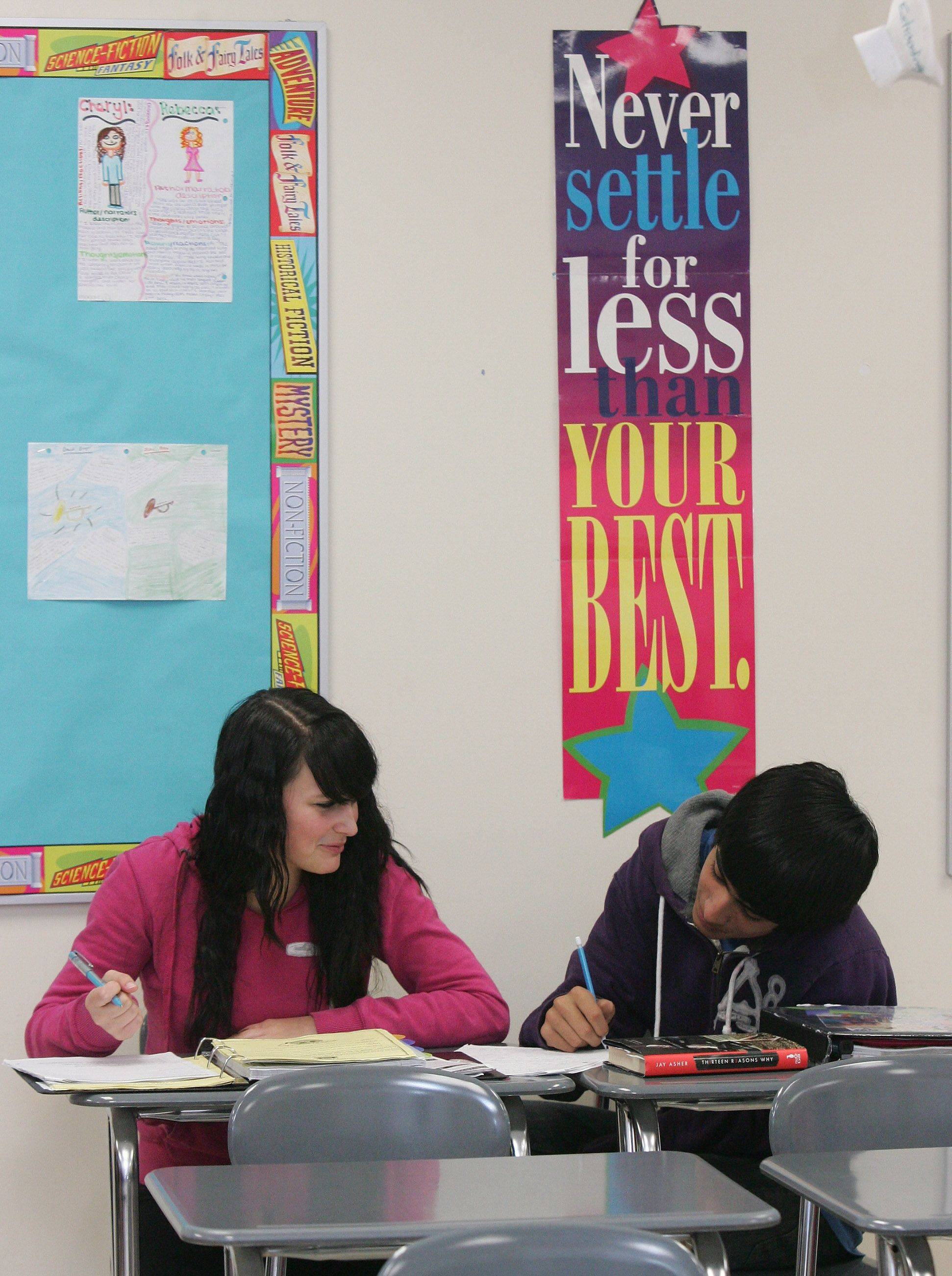 Eighth-graders Shauna MacMillan, 14, and Alex Mendez, 13, work together to write a story in literature class at Matthews Middle School in Island Lake. Matthews was one of three Wauconda District 118 schools that met adequate yearly progress standards established under the No Child Left Behind Act.