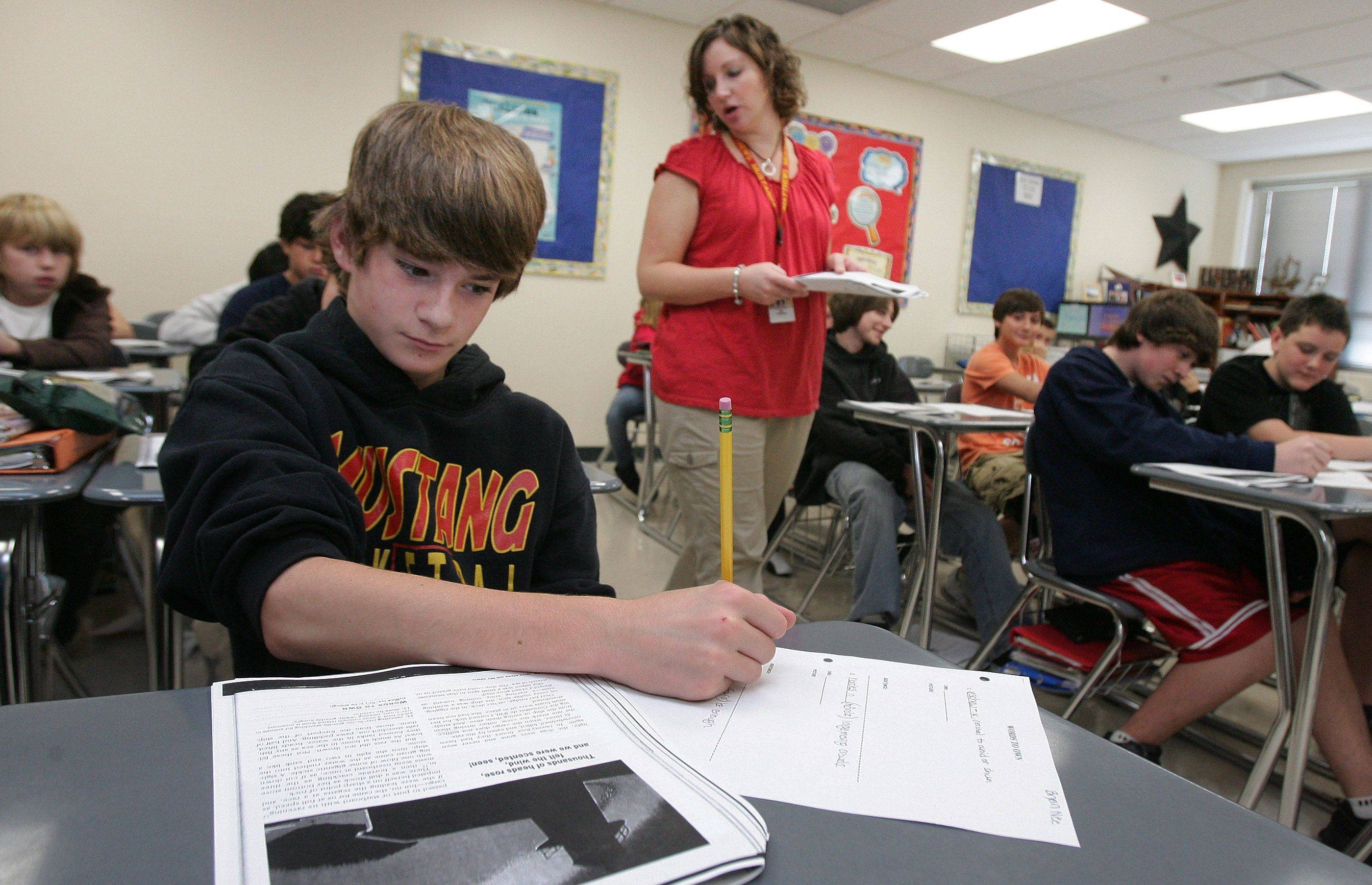 Seventh-grader Bryan Nee, 12, takes notes during a language arts lesson by teacher Brooke Farrant at Matthews Middle School in Island Lake. Matthews was one of three Wauconda District 118 schools that met adequate yearly progress standards established under the No Child Left Behind Act.