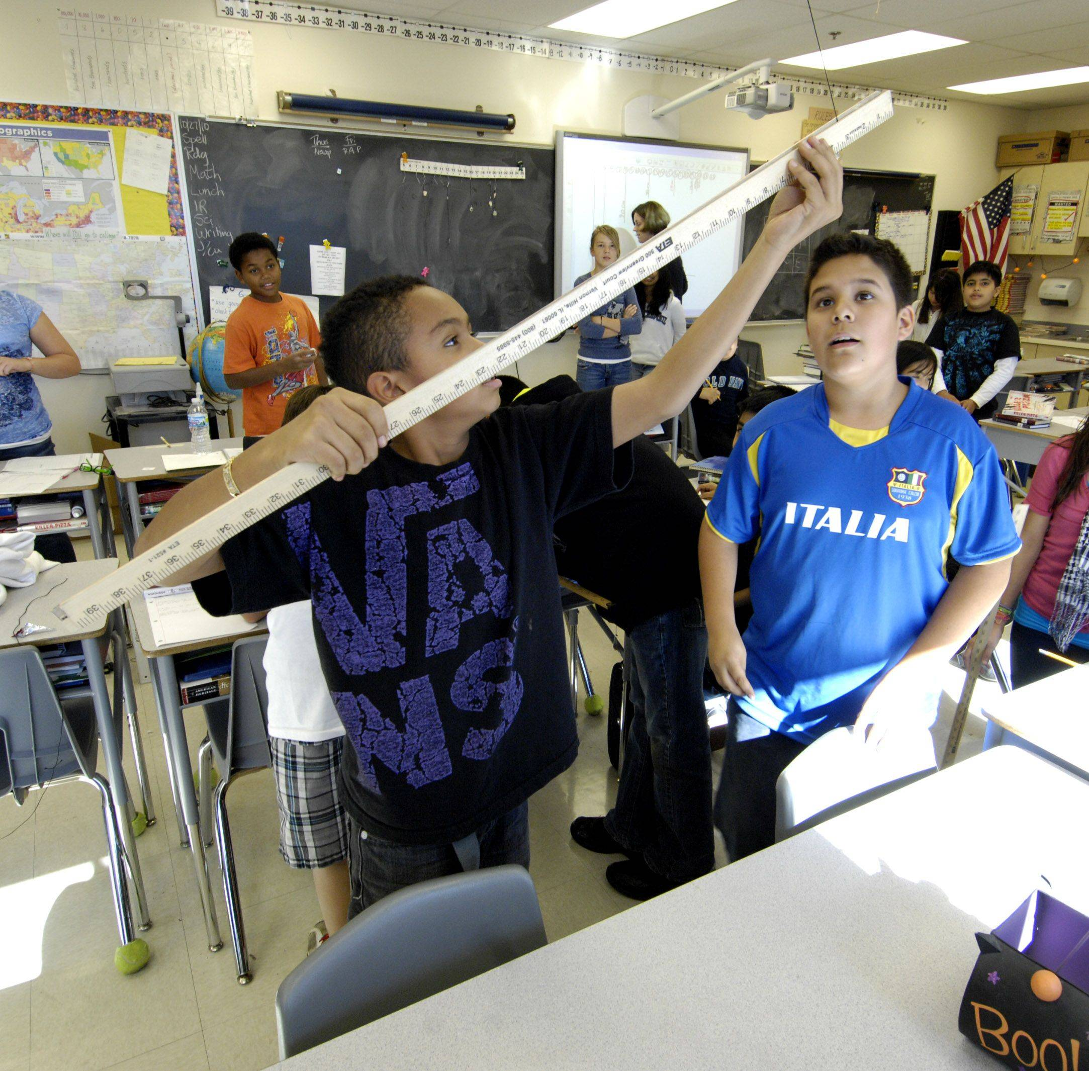 Sixth-graders Marcelino Sandoval and Jose Corona work on a project at Timber Trails Elementary School, an Elgin Area School District U-46 building in Hoffman Estates.