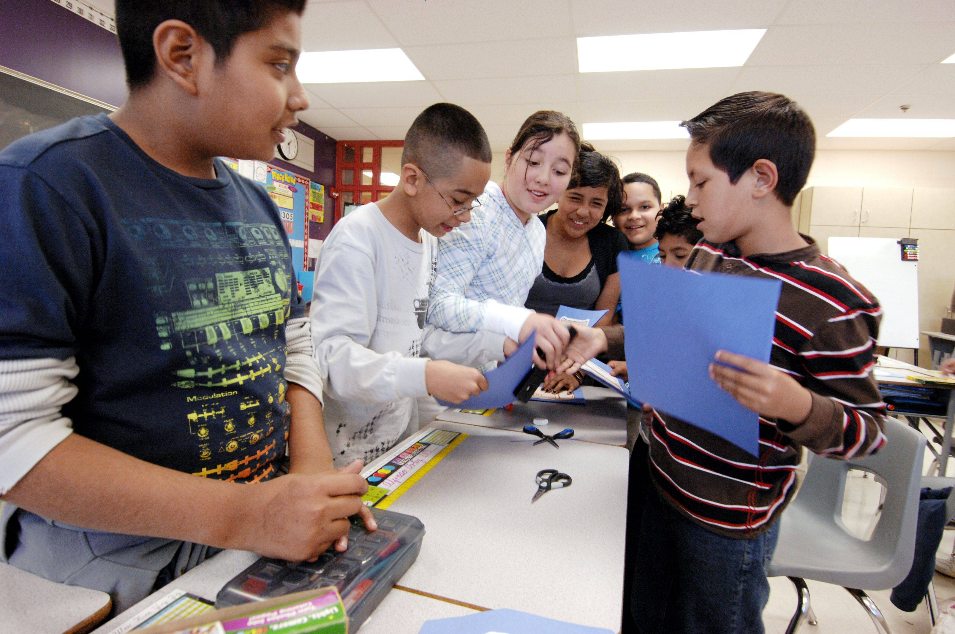 Students in an English Language Learners class at Timber Trails Elementary School in Hoffman Estates work on a project.