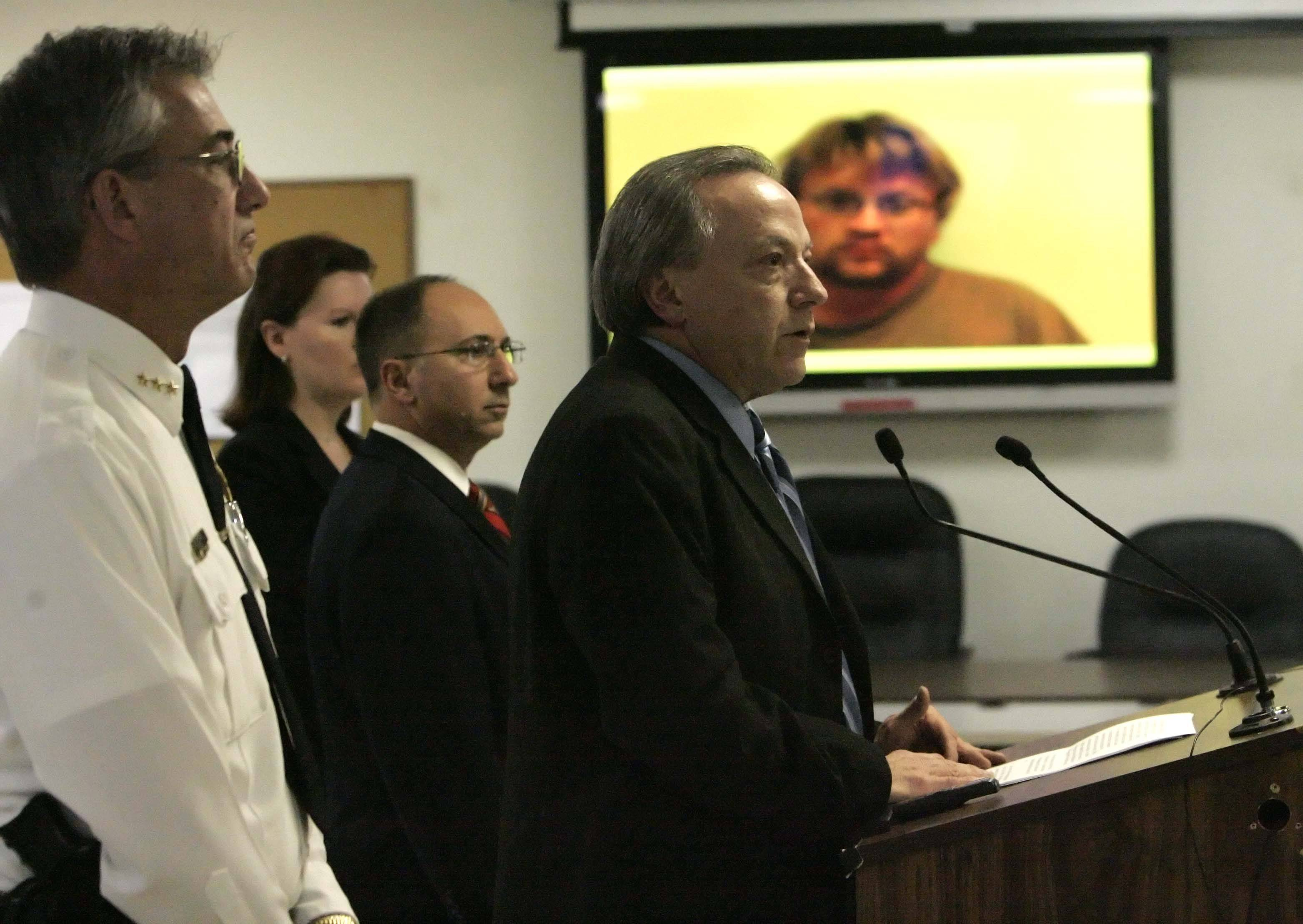 "DeKalb County State´s Attorney John Farrell, center, and DeKalb police Chief Bill Feithen hold a news conference Friday to announce charges against William ""Billy"" P. Curl, 34, of DeKalb with the murder of 18-year-old Antinette ""Toni"" Keller."