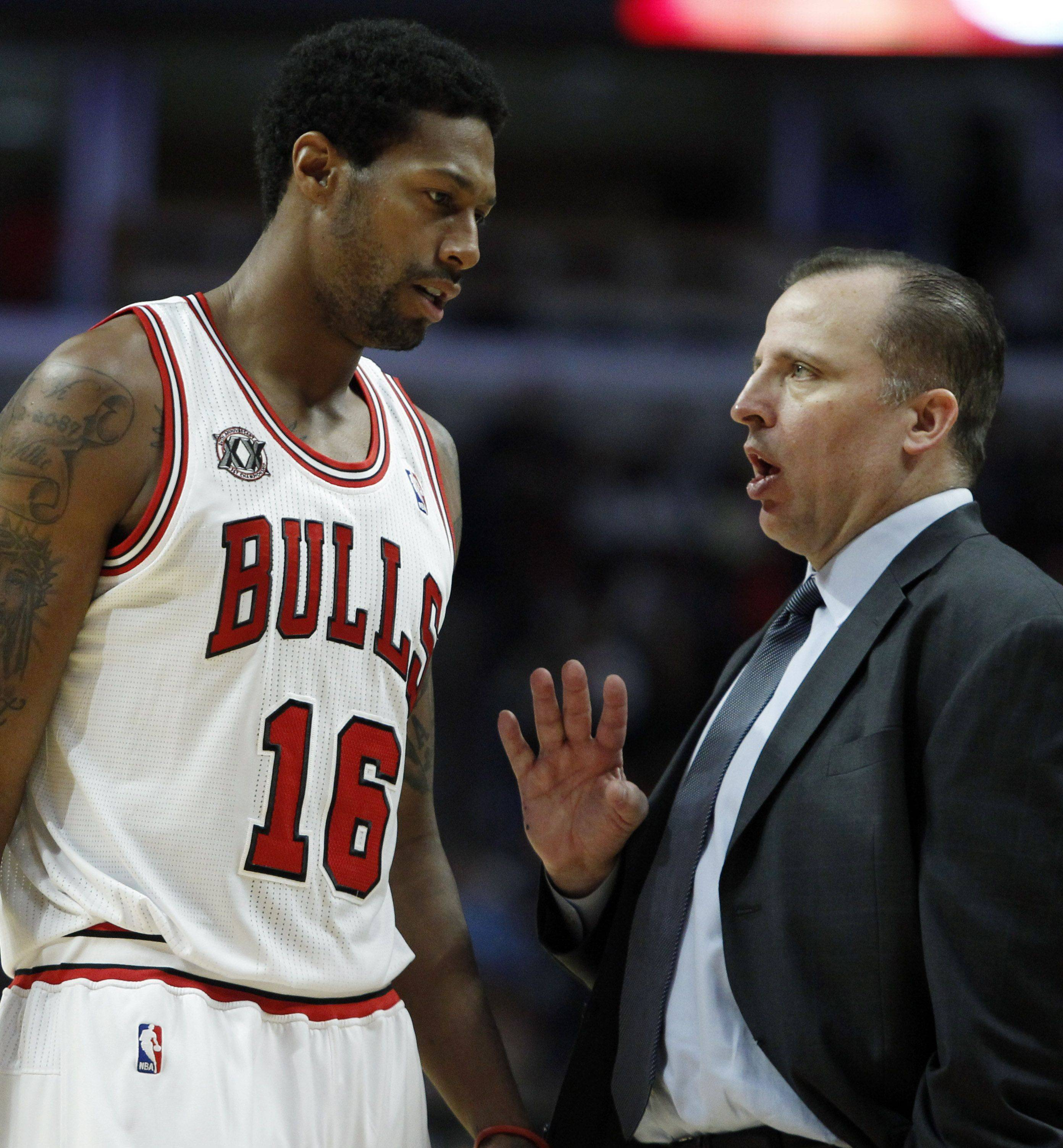 Chicago Bulls head coach Tom Thibodeau, right, talks to James Johnson during the fourth quarter of a preseason NBA basketball game against the Indiana Pacers in Chicago, Friday, Oct. 22, 2010. The Bulls won 102-74.