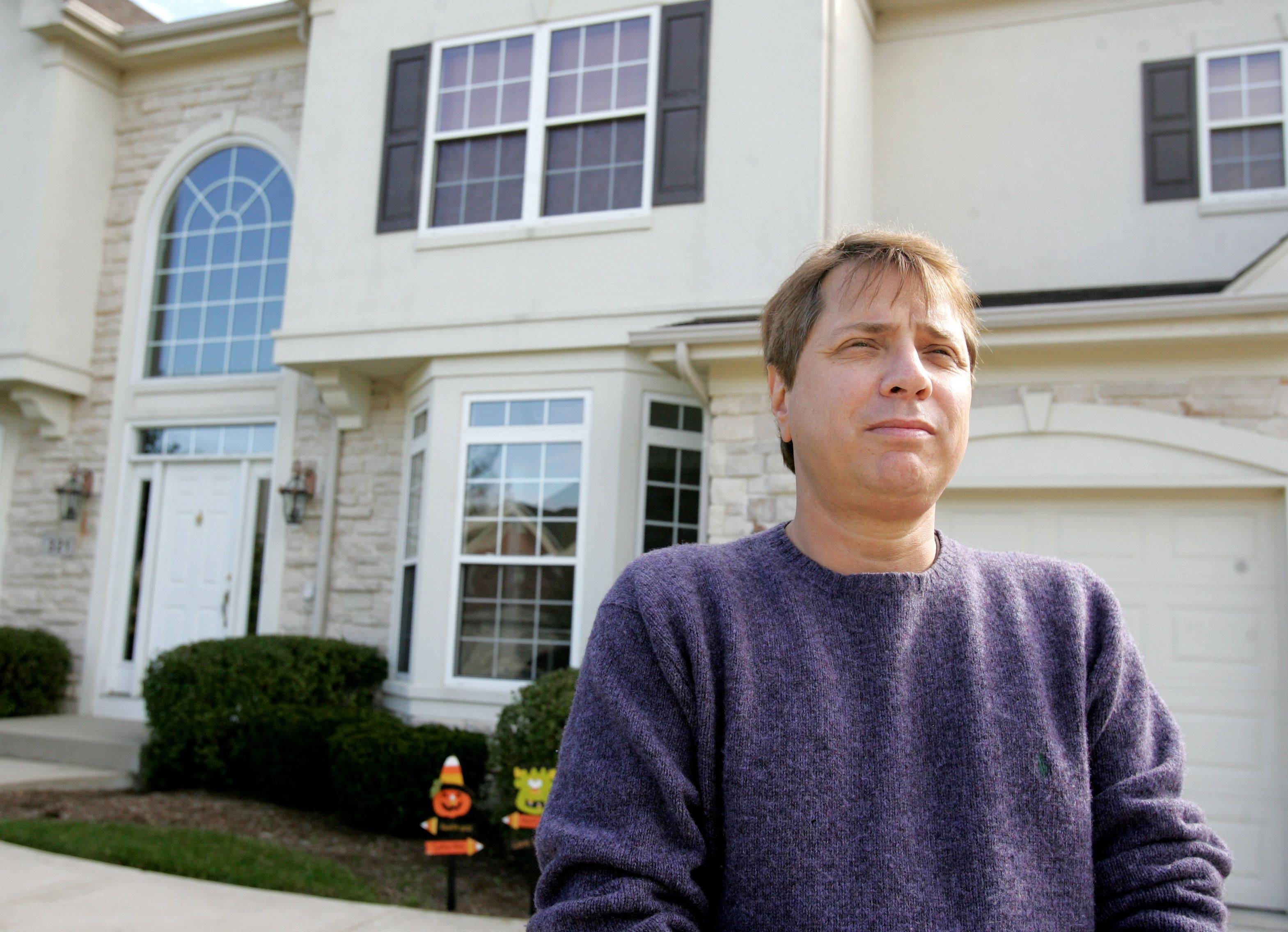 A divorce and medical disability helped push Michael Slowik's debt to $140,000. He filed for bankruptcy but is fighting to keep his Bloomingdale home.