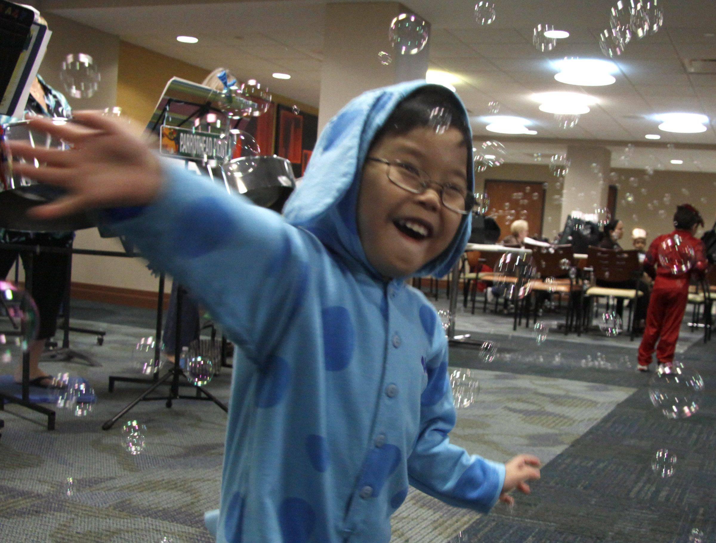James Kaphengst, 4, dances in the bubbles at the Central DuPage Hospital's 24th annual reunion of neonatal intensive care unit patients and their families. Kaphengst was only 34 weeks along when his mother, Stephanie who is also a nurse at Central DuPage Hospital, gave birth.