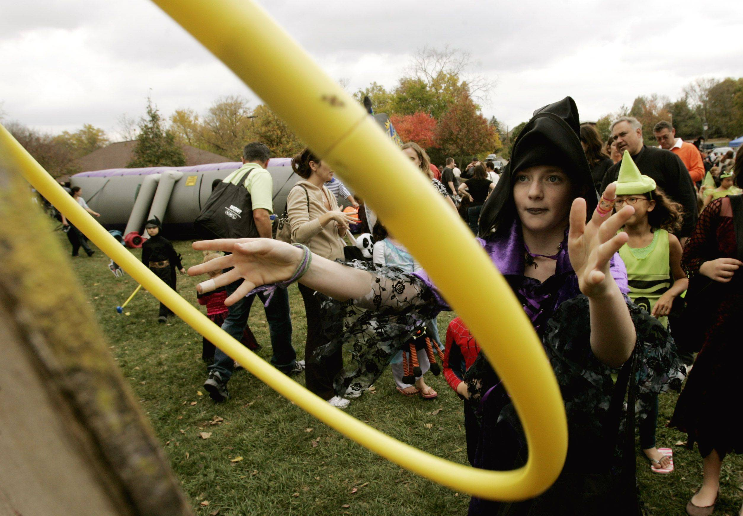 Madeline Cediker,9, of Naperville is plays a frankenstein ring toss game Sunday during Halloween Happening at the Grand Pavilion along Naperville's Riverwalk.
