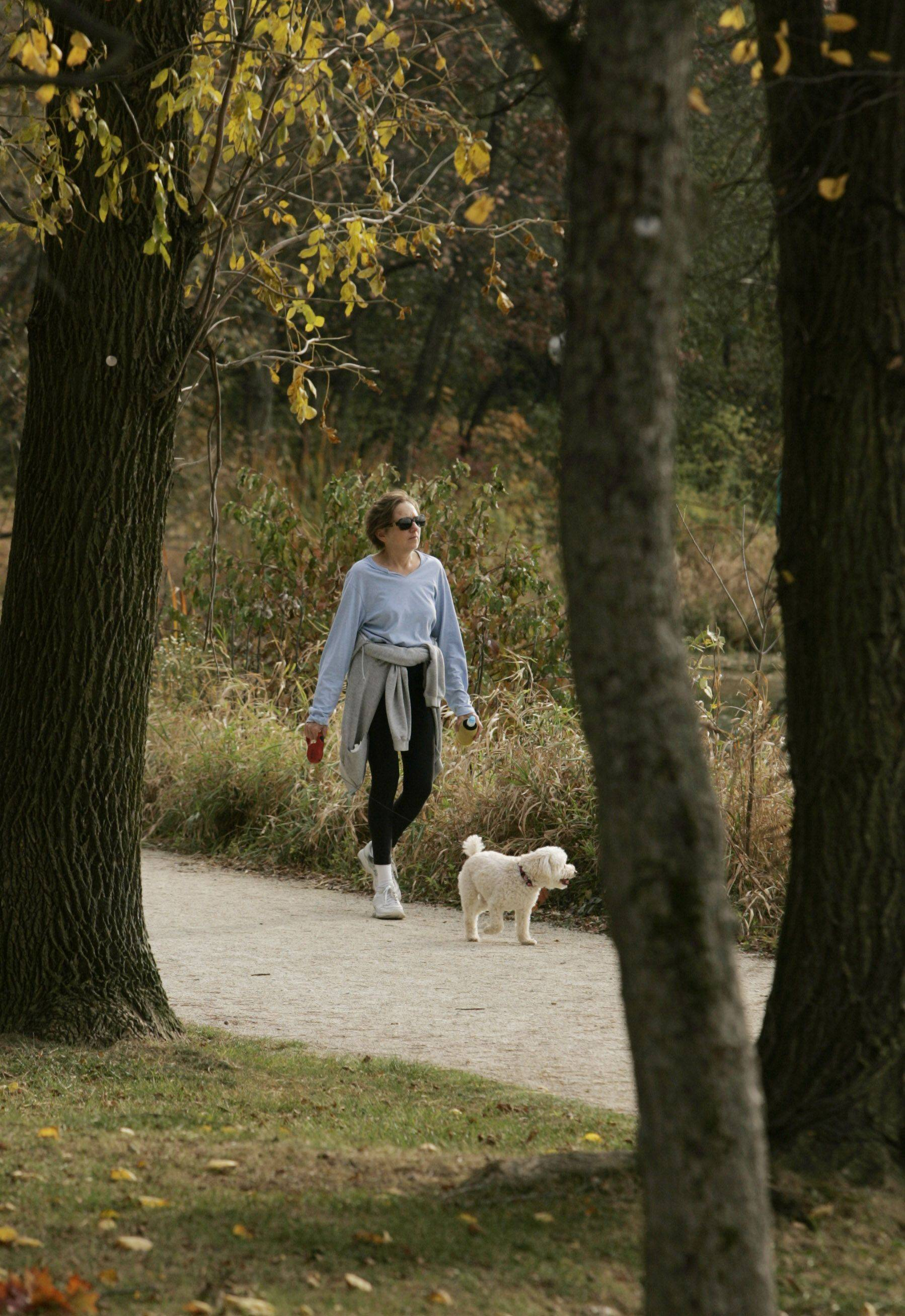 Rose Carr of Wheaton and her dog, Sierra, enjoy a nice day Monday at Herrick Lake Forest Preserve in Wheaton.