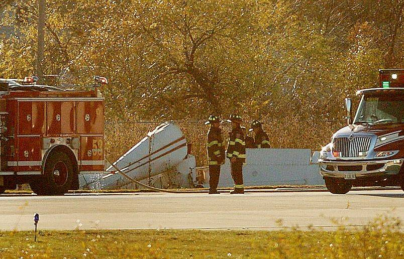 Schaumburg firefighters at the scene of a fatal plane crash at the Schaumburg airport Monday afternoon.