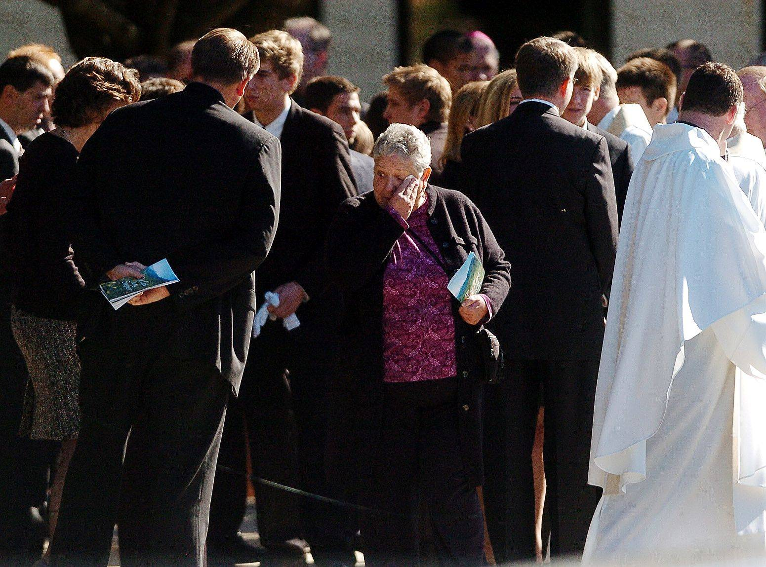 Family members console each other after the funeral for Declan Sullivan.