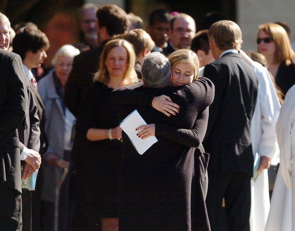 Family members of Declan Sullivan are consoled at the funeral Monday in Buffalo Grove.