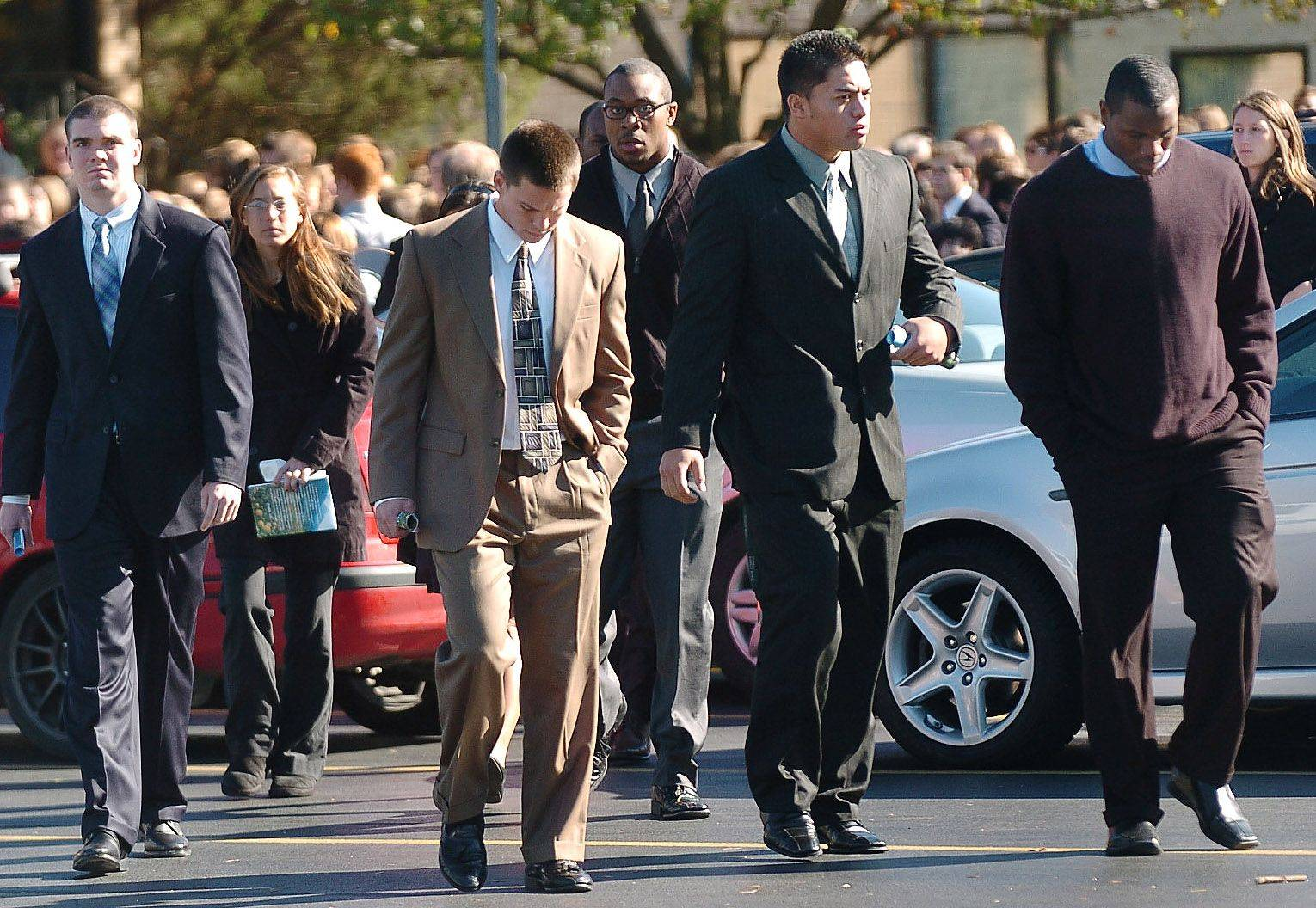 Notre Dame football players leave St. Mary Catholic Church after the funeral for Declan Sullivan.