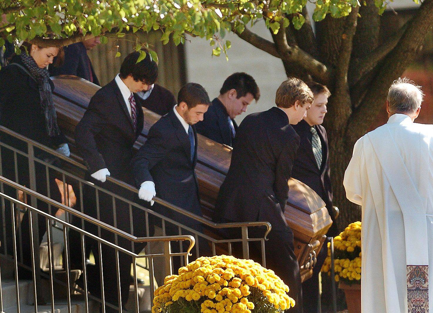 Pallbearers carry the casket of Declan Sullivan out of St. Mary Catholic Church after his funeral.