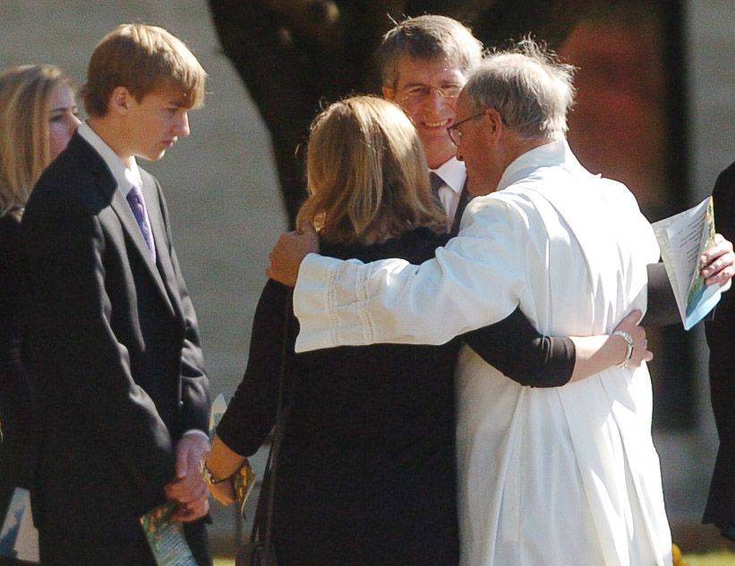 Family members of Declan Sullivan are consoled after the funeral Monday in Buffalo Grove.