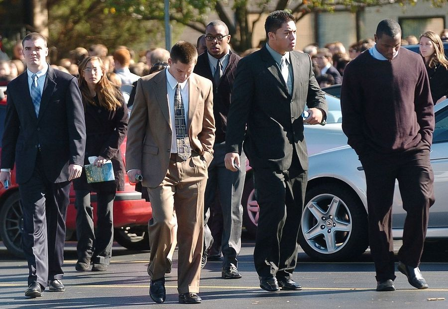 Notre Dame football players, including linebacker Manti Teo (second from right), leave St. Mary Catholic Church on Monday after the funeral for Declan Sullivan.