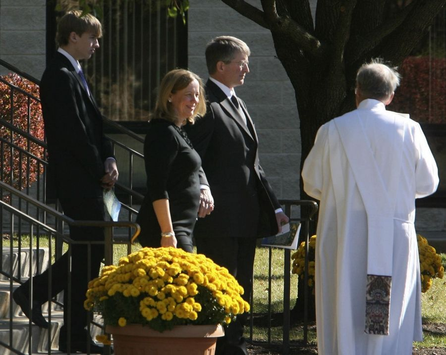 Declan Sullivan's parents, Alison and Barry Sullivan, center, leave their son's funeral Mass on Monday in Buffalo Grove.