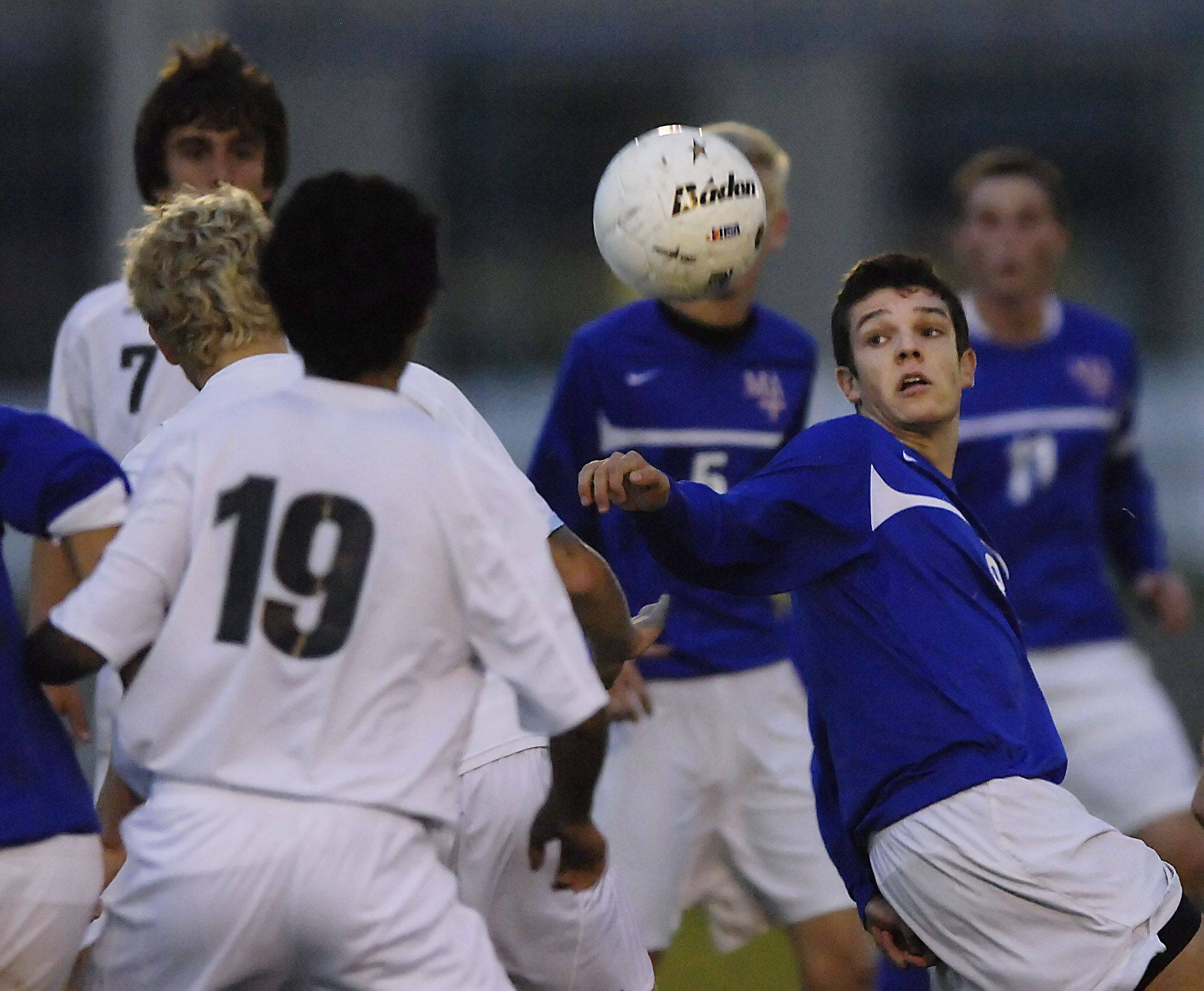 Marmion Academy's Mike Frasca fights for another shot in front of the Burlington Central net Monday.