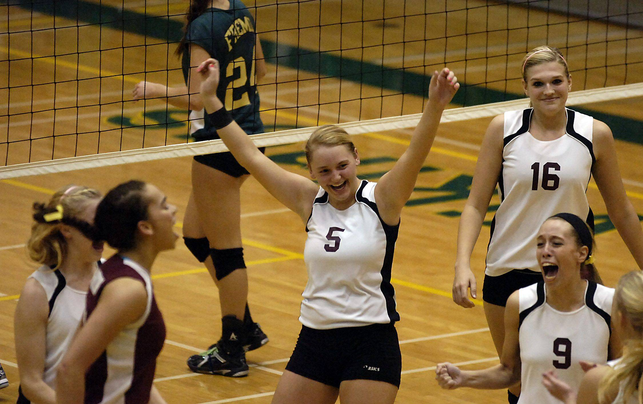 Zion-Benton's Torie Pasiewicz celebrates with her teammates after beating Fremd in game three of the girls volleyball regional semifinals at Fremd High School on Thursday.