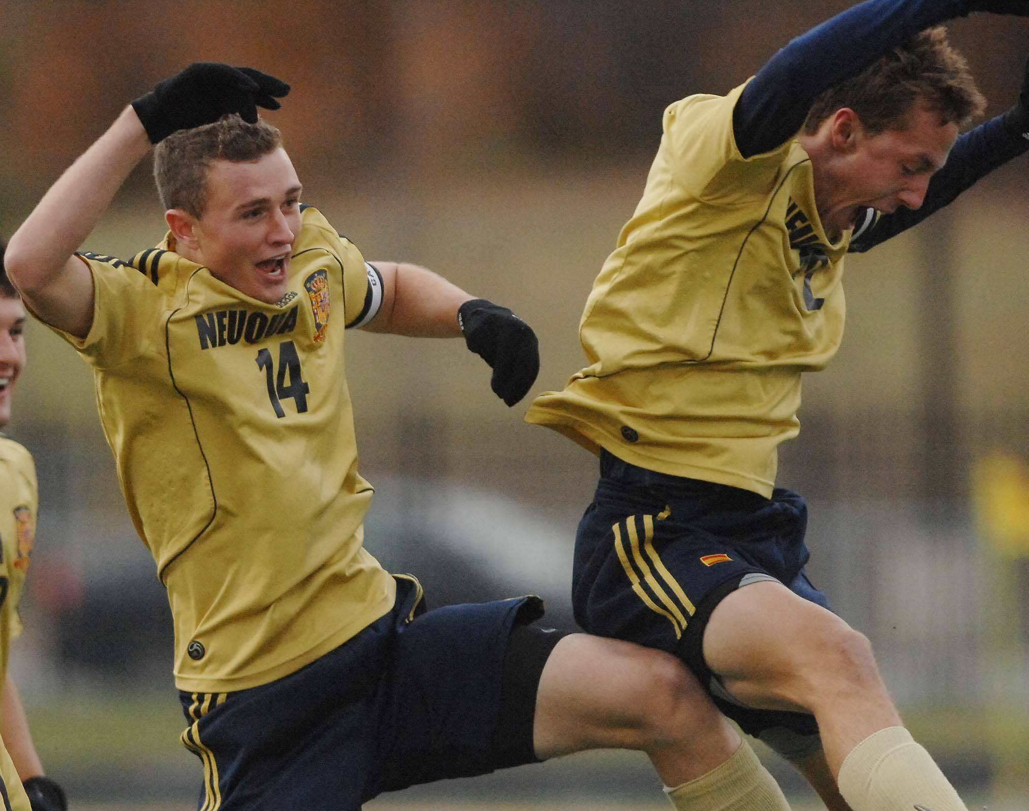 Jacob Brindle, left, and Pat Doody of Neuqua Valley celebrate after a first-half goal against East Aurora Thursday.
