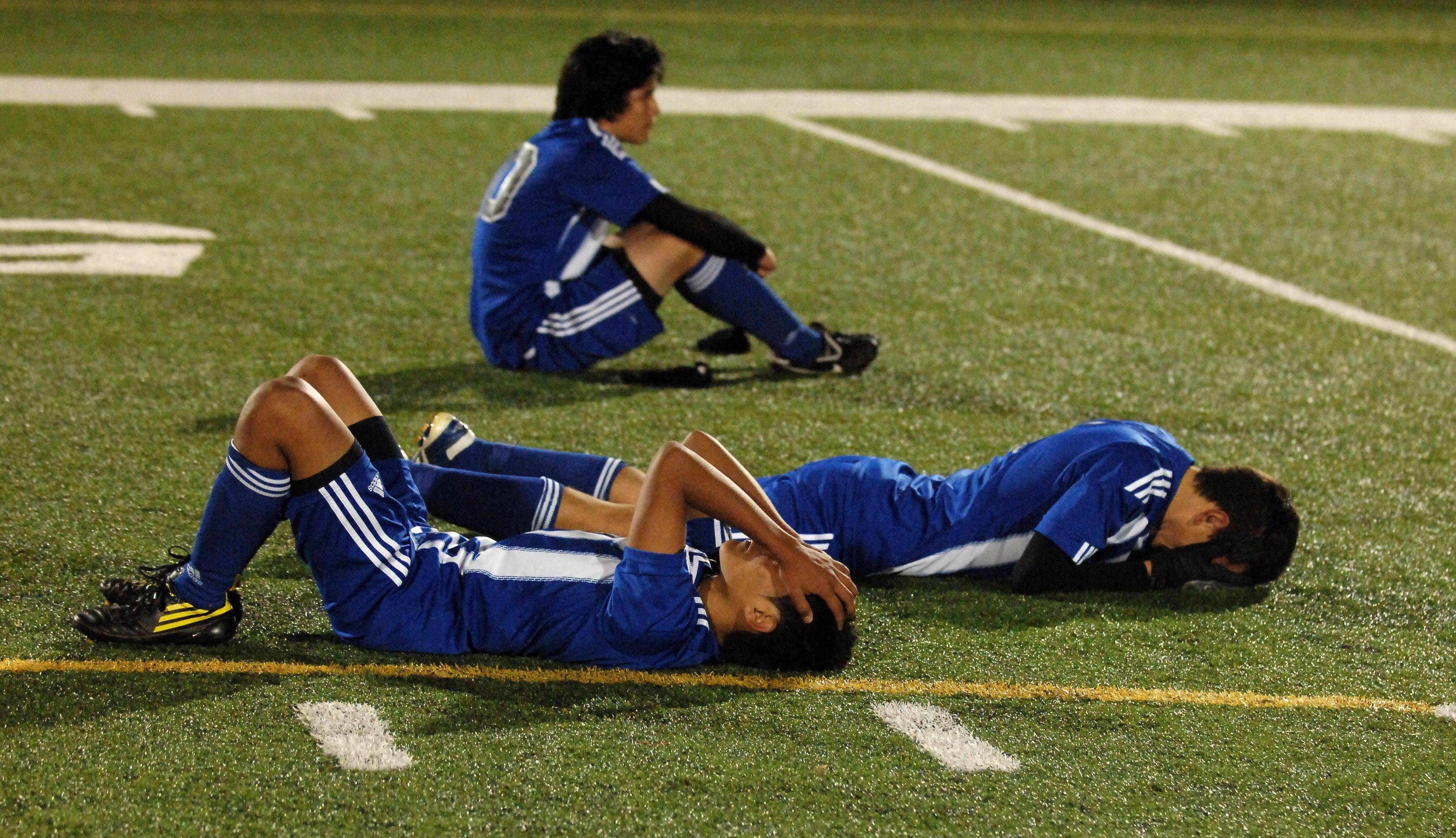 Larkin's Danny Ramirez, front to back, Jose Huertado and Erik Rodriguez react to losing in penalty kicks to Rockford Boylan during Thursday's Barrington soccer sectional.