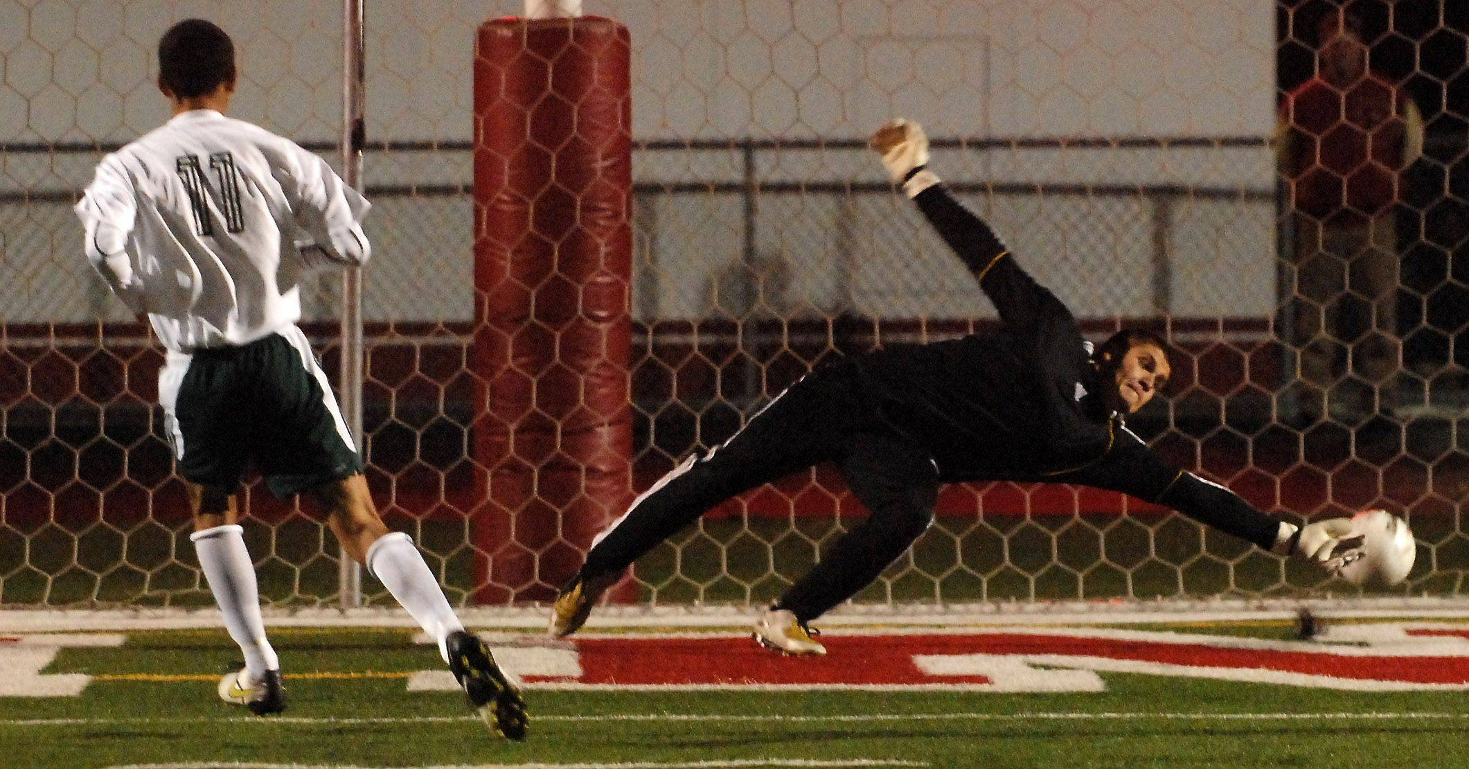 Larkin goalkeeper Santiago Guerrero can't stop a penalty kick by Rockford Boylan's Edwin Munoz during Thursday's Barrington soccer sectional.