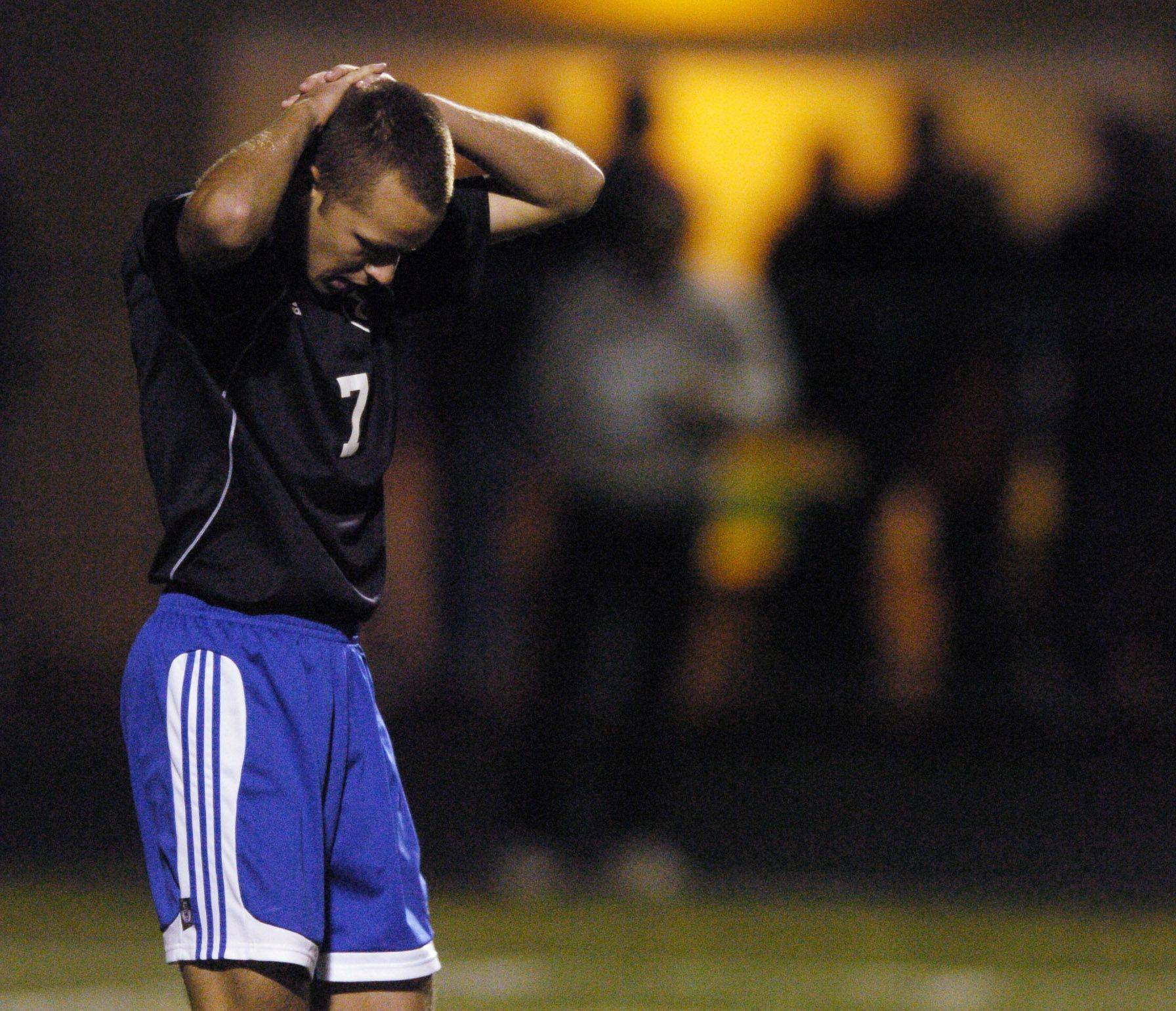 Joshua Poythress of Geneva reacts to missing a shot during the double shoot out with Leyden during the boys soccer semifinals at Schaumburg.