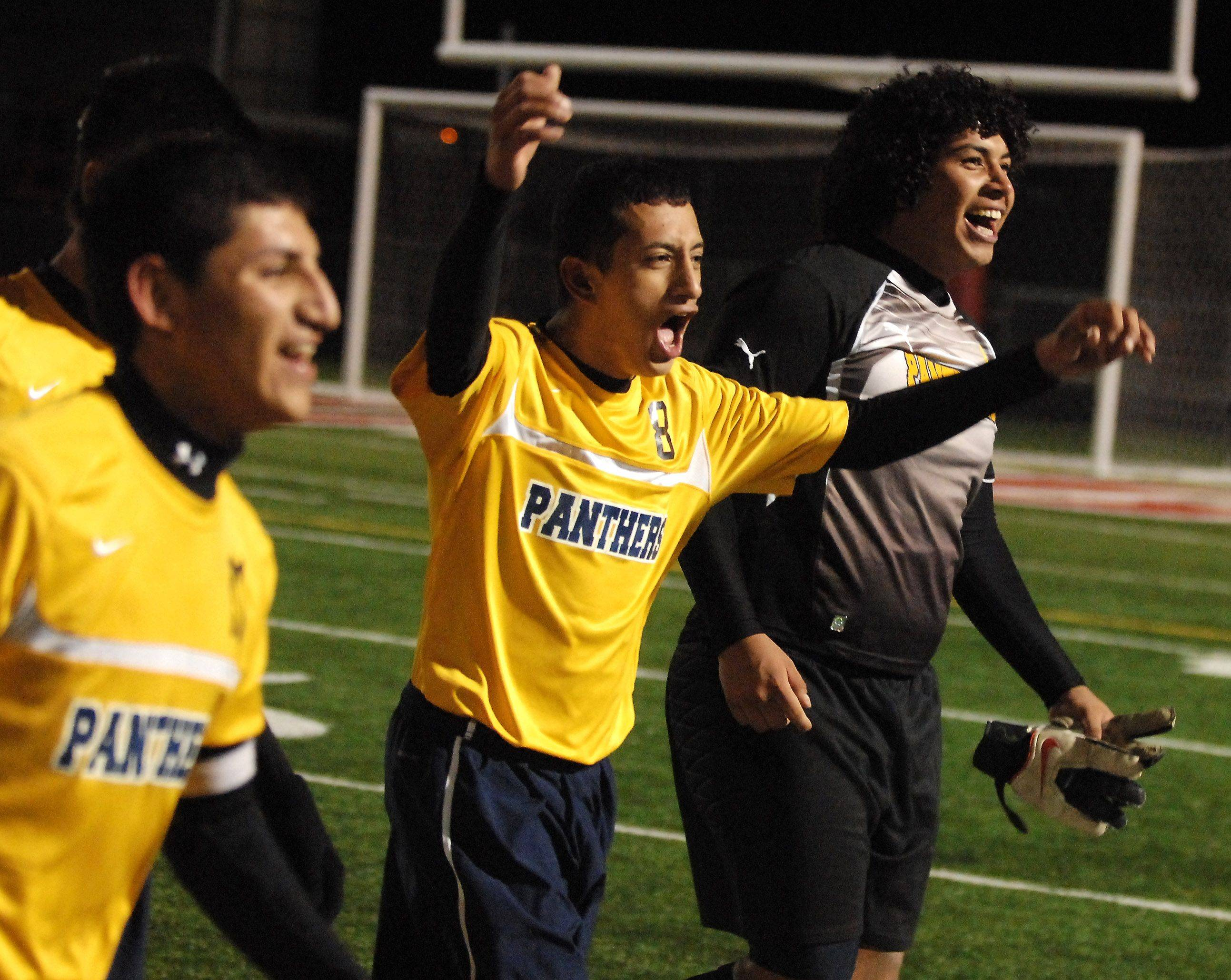 Round Lake's Armando Alvarez, center, and goalkeeper Luis Leon celebrate their win over Crystal Lake South in Thursday's Barrington soccer sectional.