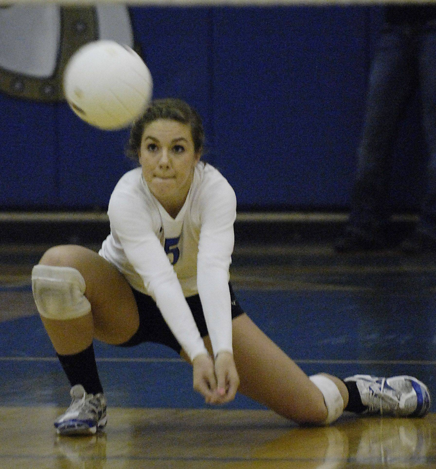 Geneva's Ashleigh Shain digs a shot by Wheaton North Thursday in Geneva.