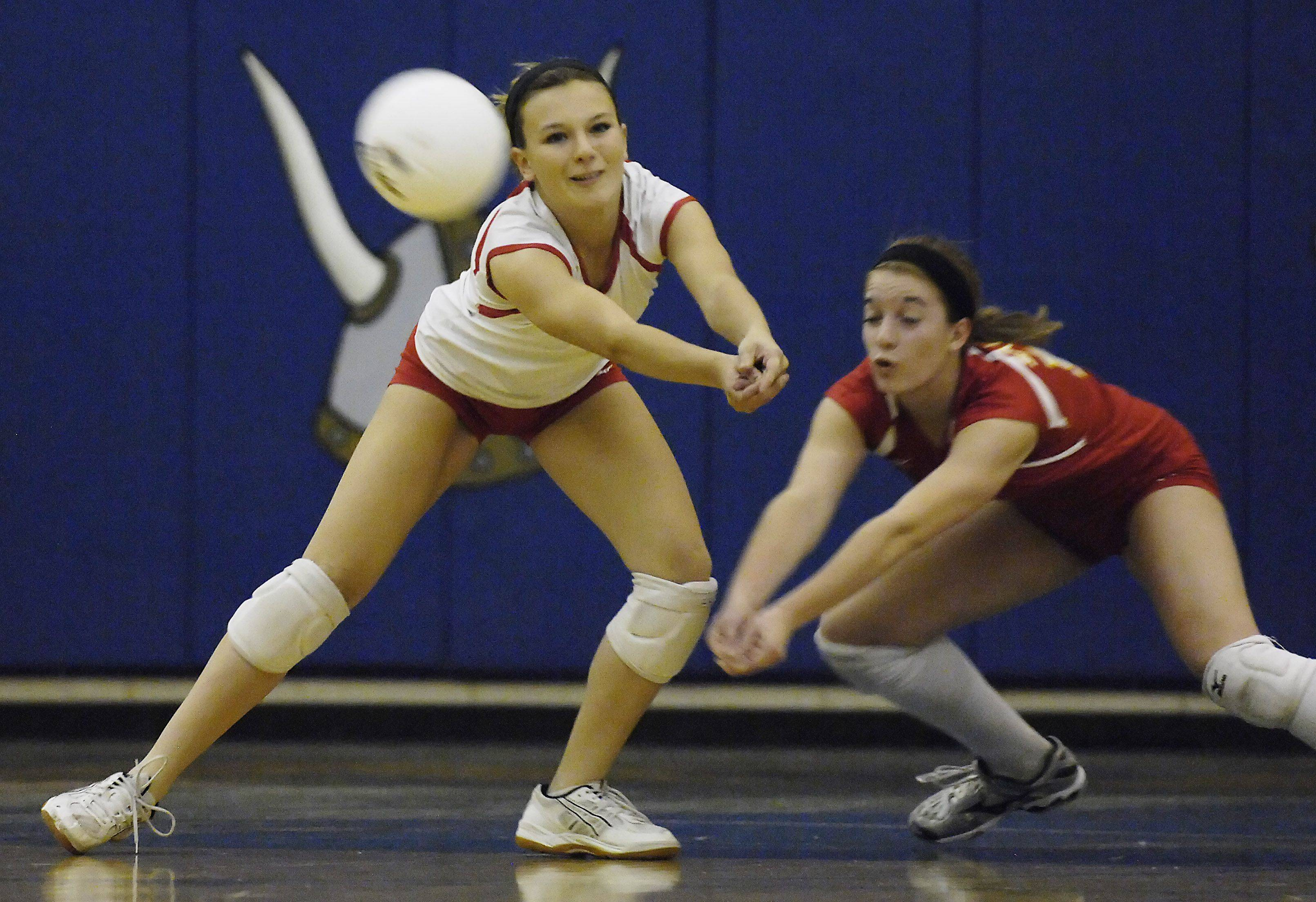 Batavia's Meghan Fabian and Stephanie Kinane, right, retrieve a Matea Valley serve Thursday night in Geneva.