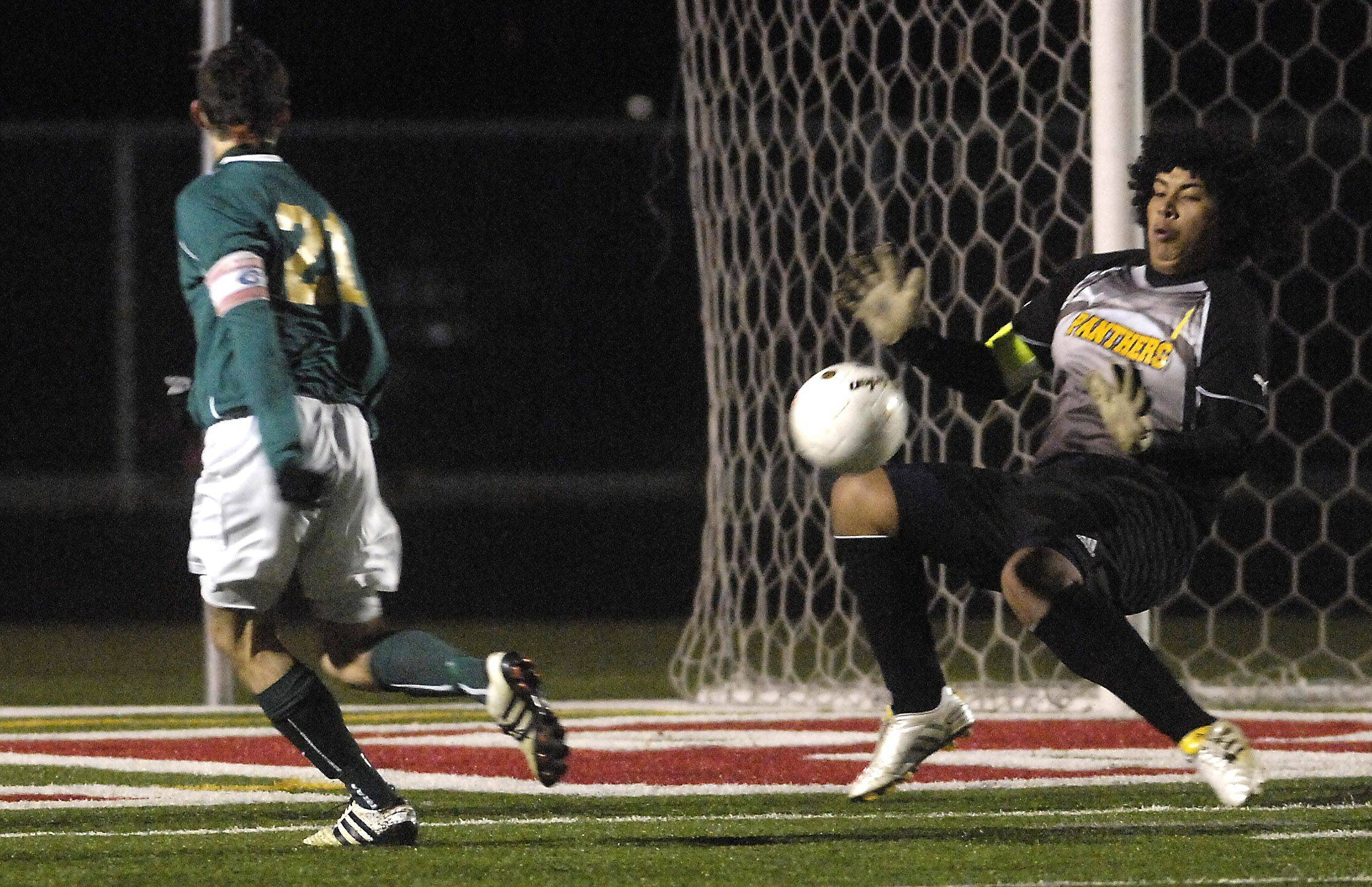 Round Lake goalkeeper Luis Leon stops a point blank shot by Crystal Lake South's Charlie Oliver during Thursday's Barrington soccer sectional.