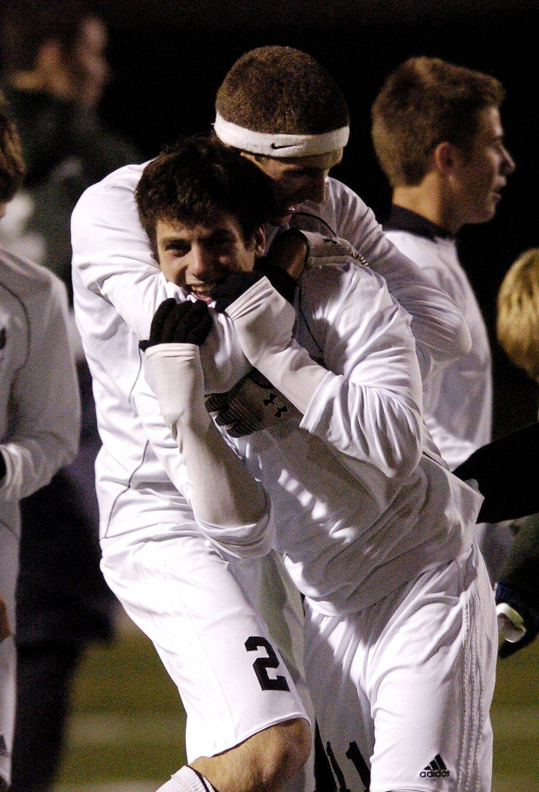 Charlie Sordini, 11, of Bartlett gets a hug from a teammate after scoring the winning goal during single overtime gameagainst Elk Grove in the boys soccer semifinals at Schaumburg.