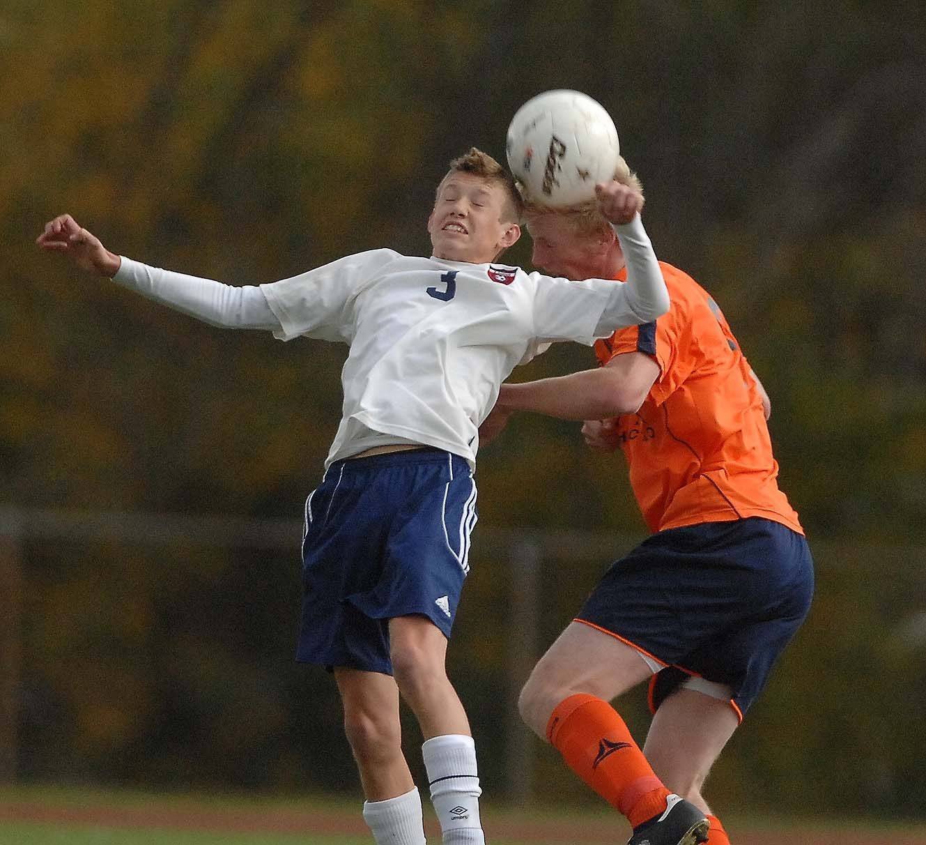 Eric Osika, of Lisle, left, and Ian Beihl go up for a header during the Lisle an Latin boys soccer sectional final in Lisle Tuesday.