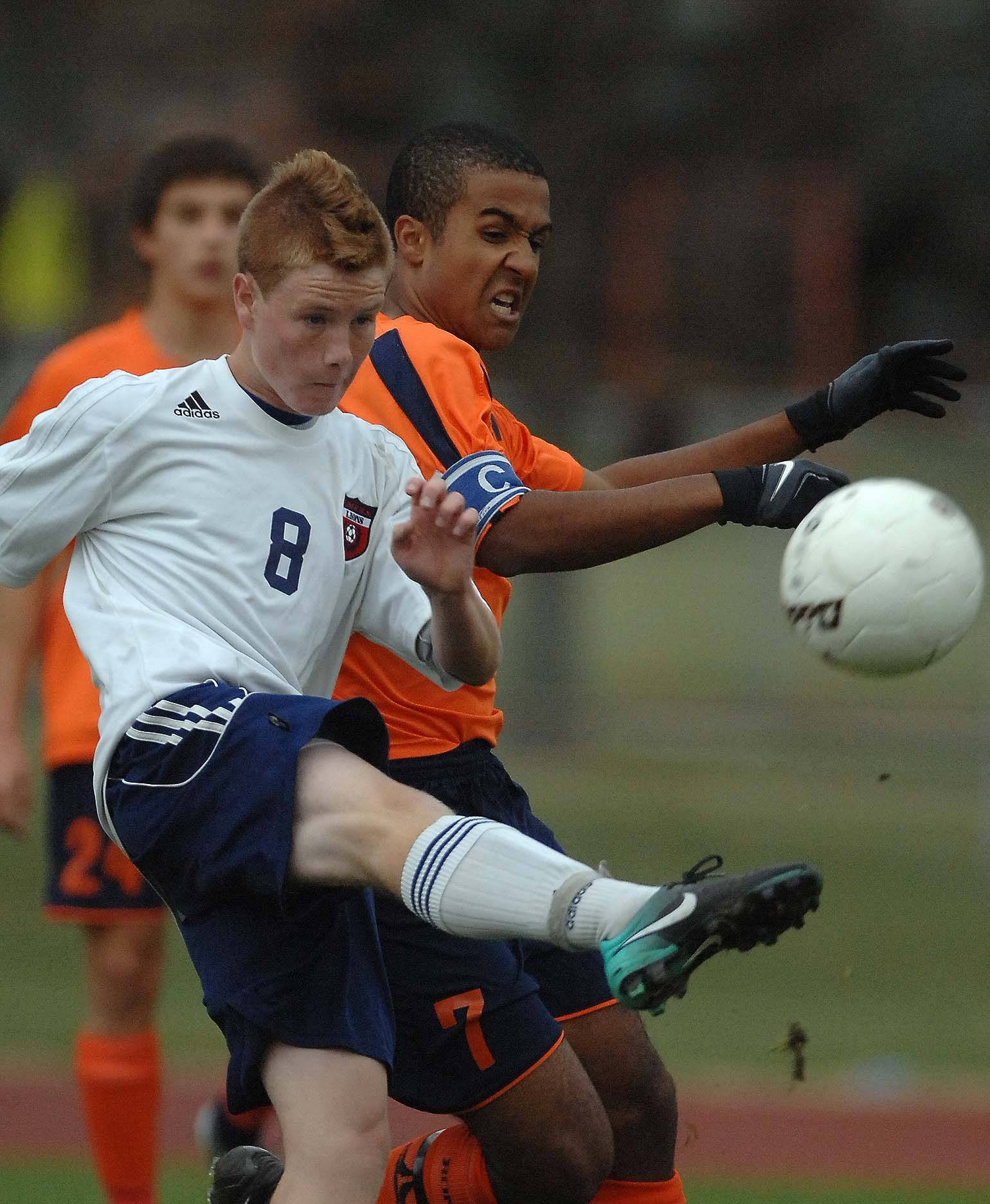 Pat Webb of Lisle,left, and Alexander Dago of Latin vie for the ball. This took place during the Lisle vs. Latin boys soccer sectional final in Lisle Tuesday.