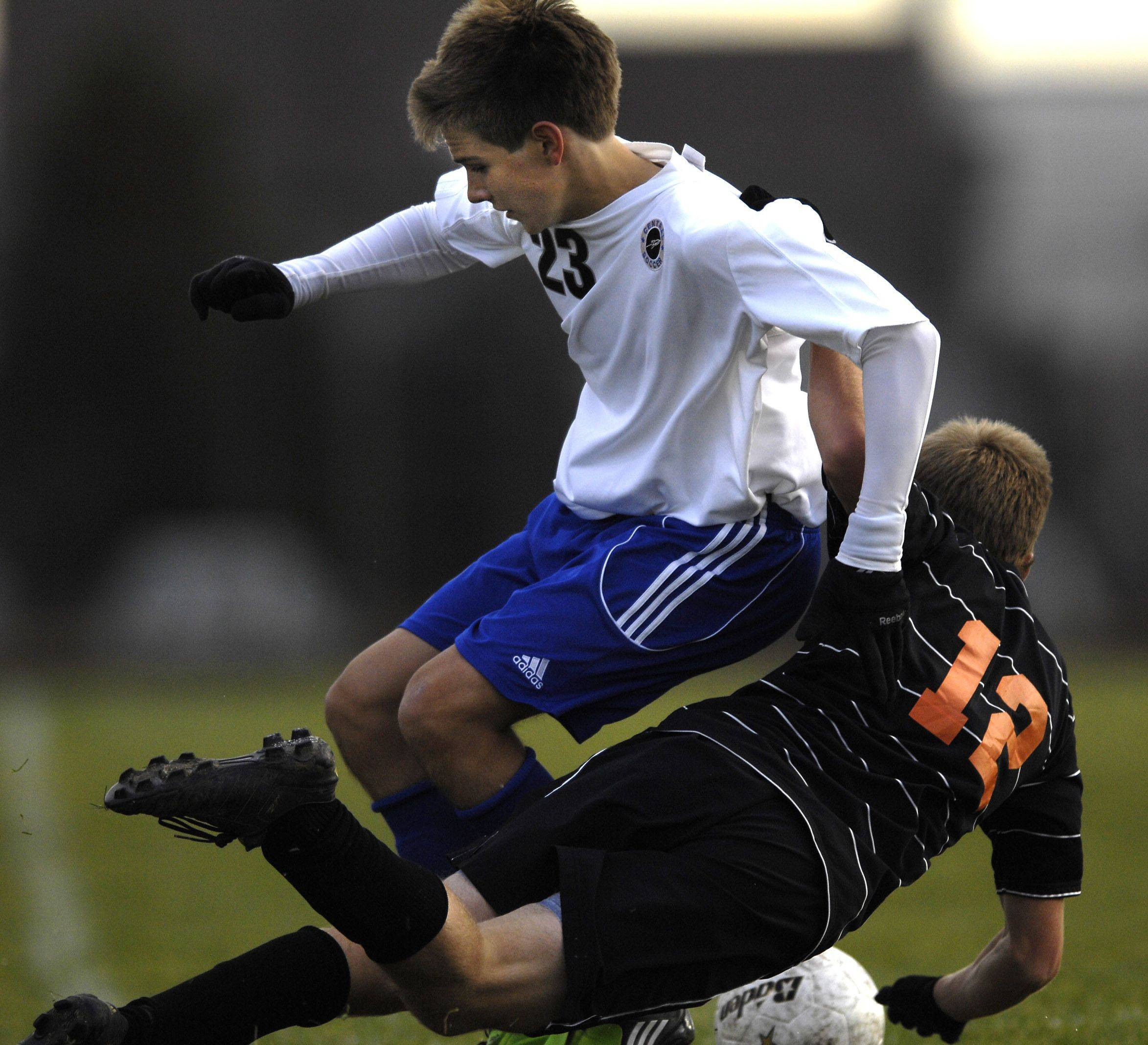 Burlington Central's Grant Stoneman knocks Freeport's Danny Steenrod off the ball in the Class 2A sectional semifinal game Wednesday in Belvidere.