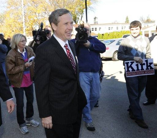 U.S. Rep. Mark Kirk exits his polling place after voting at the Highwood Community Center Tuesday.