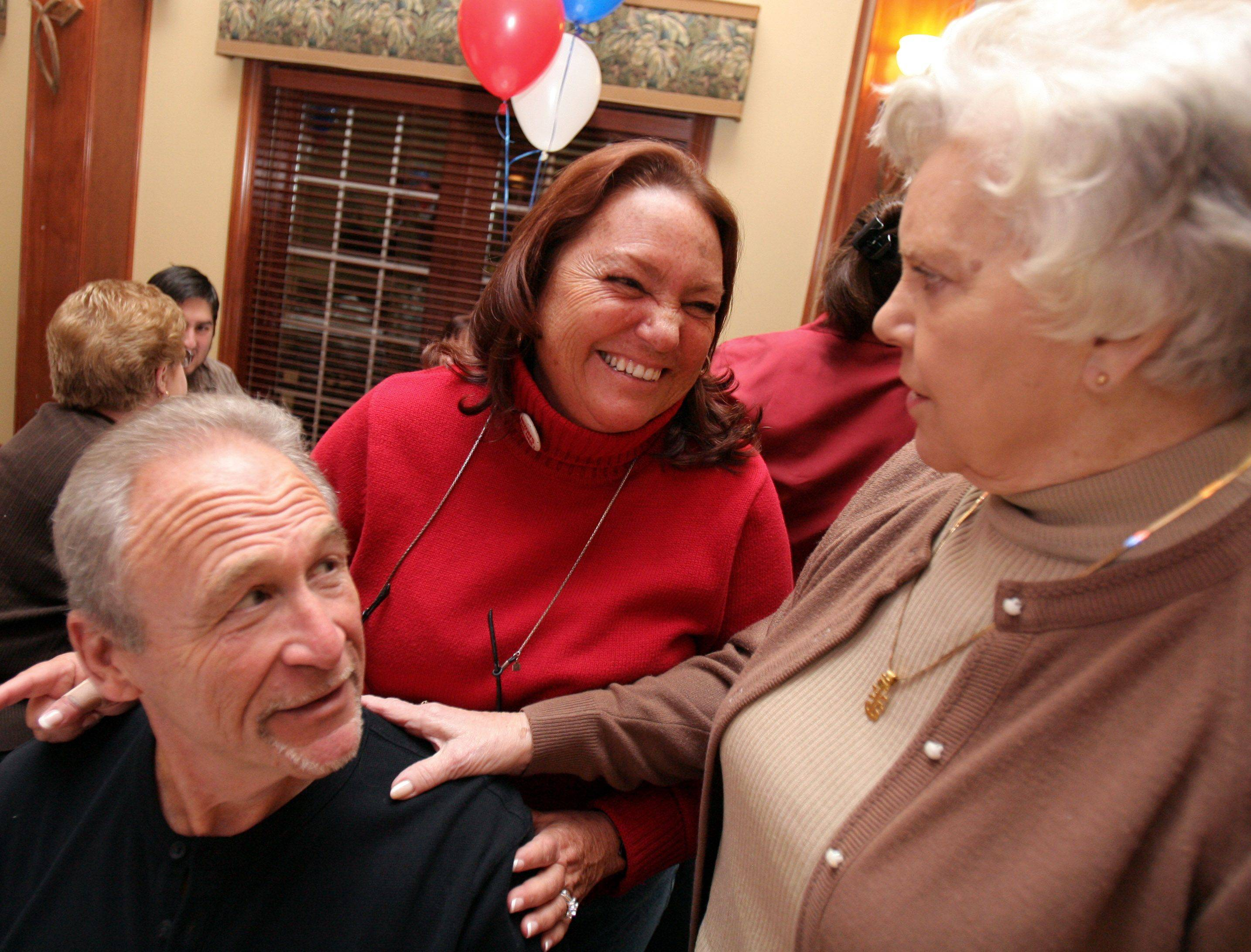 Suzi Schmidt, Republican candidate for the 31st State Senate seat, center, laughs with her husband Bob Schmidt and her mom Lou Reyes as they wait for election results at Antioch Golf Club Tuesday night.