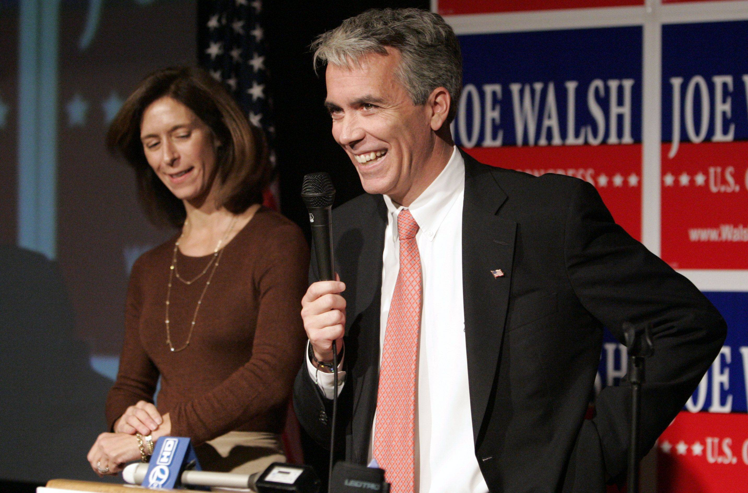 8th congressional candidate Joe Walsh and his wife, Helene, speak to supporters at the Mill Creek Banquets in Wauconda Tuesday.