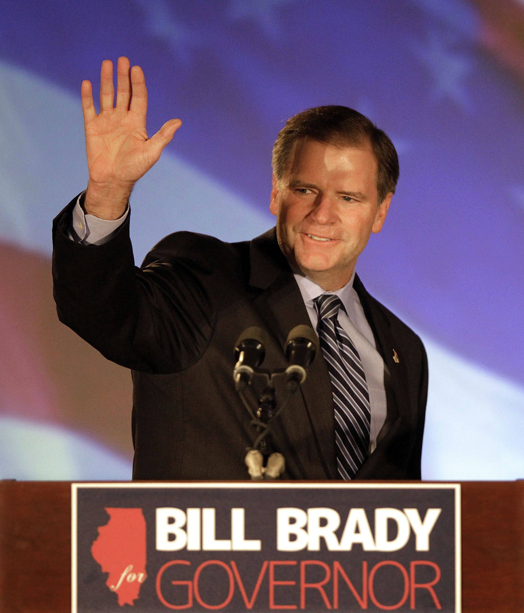 Illinois Republican gubernatorial candidate Bill Brady waves to supporters in Bloomington Wednesday, Nov. 3, 2010.
