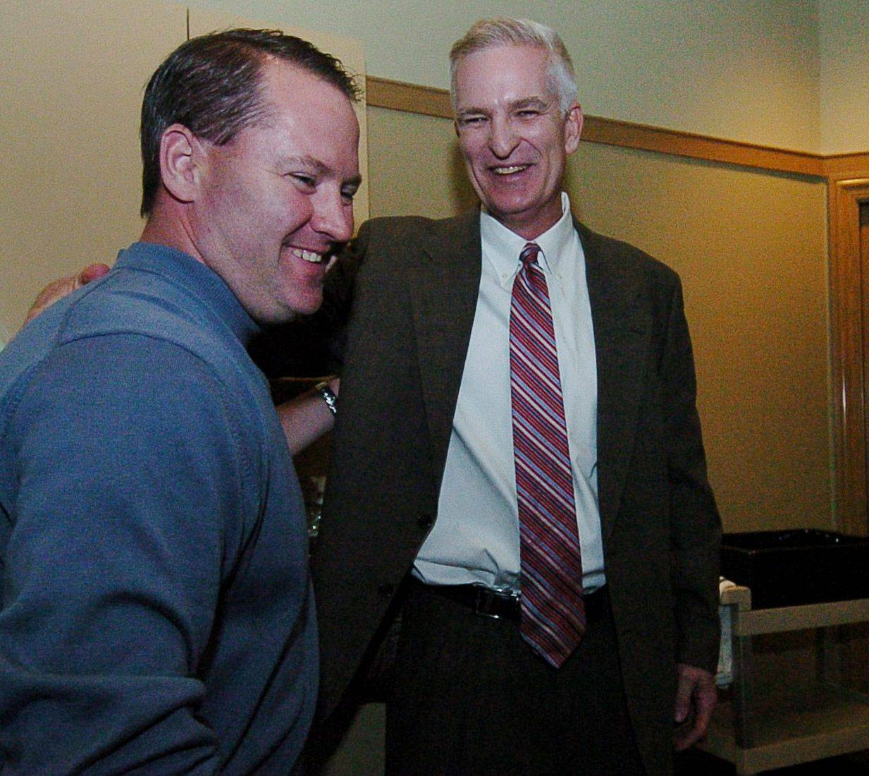 Lake County Sheriff Mark Curran, right, shakes hands with 51st District state Rep. Ed Sullivan while waiting for election results Tuesday night. Unofficial counts show Curran won his re-election bid.