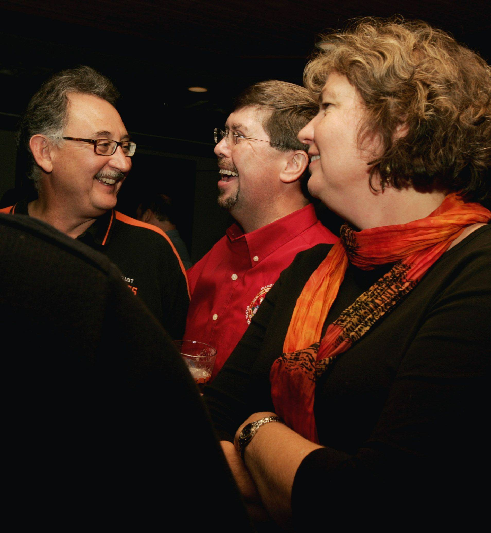 Randy Ramey, center, who was re-elected to the Illinois House in District 55, chats with supporters Edgar and Lita Jimenez of St.Charles on Tuesday night. Ramey received 62 percent of the vote and will return to Springfield for a third term.