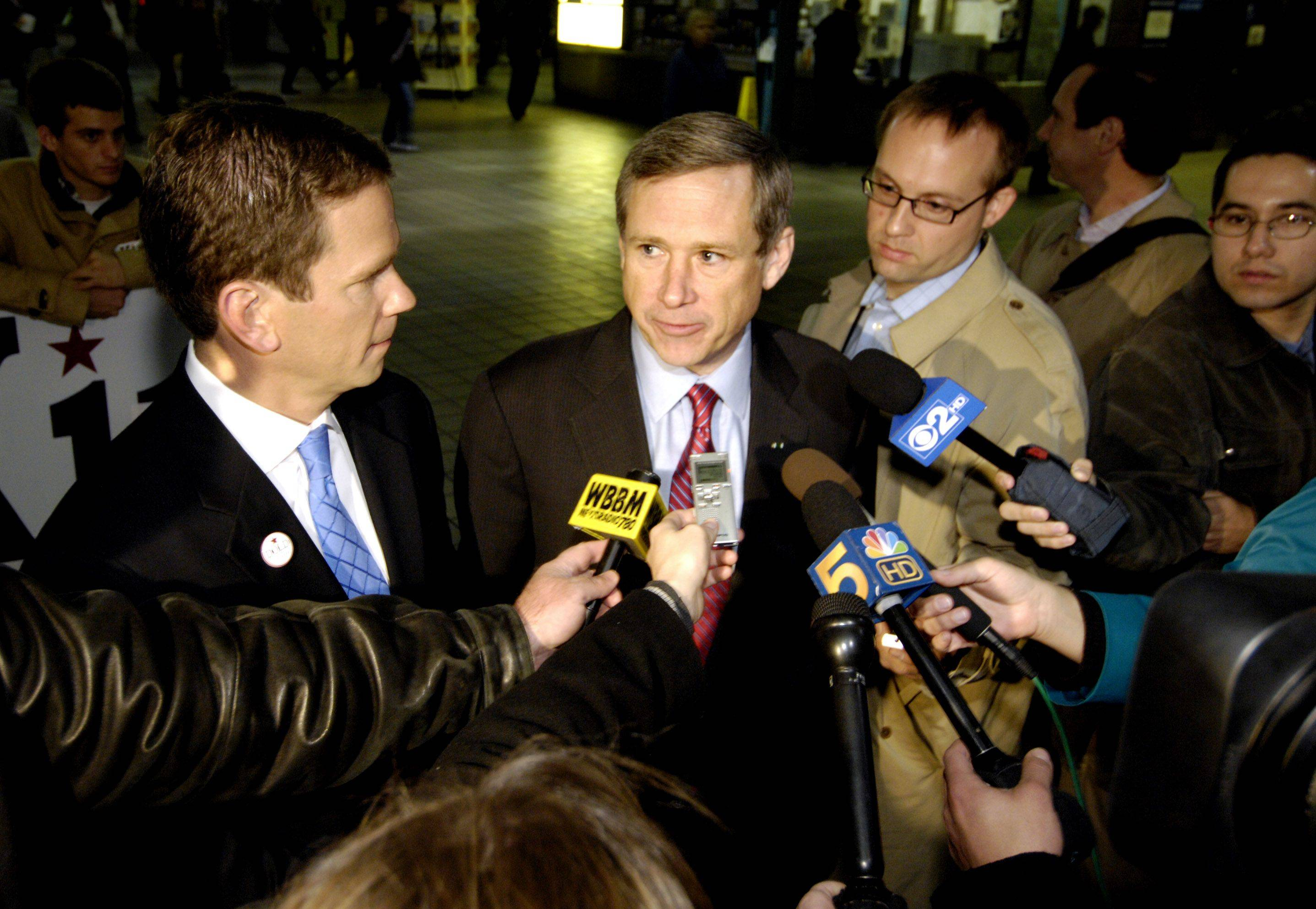 Congressman-elect Robert Dold and Illinois Senator-elect Mark Kirk talk to the media before greeting commuters at the Ogilvie Transportation Center in Chicago.