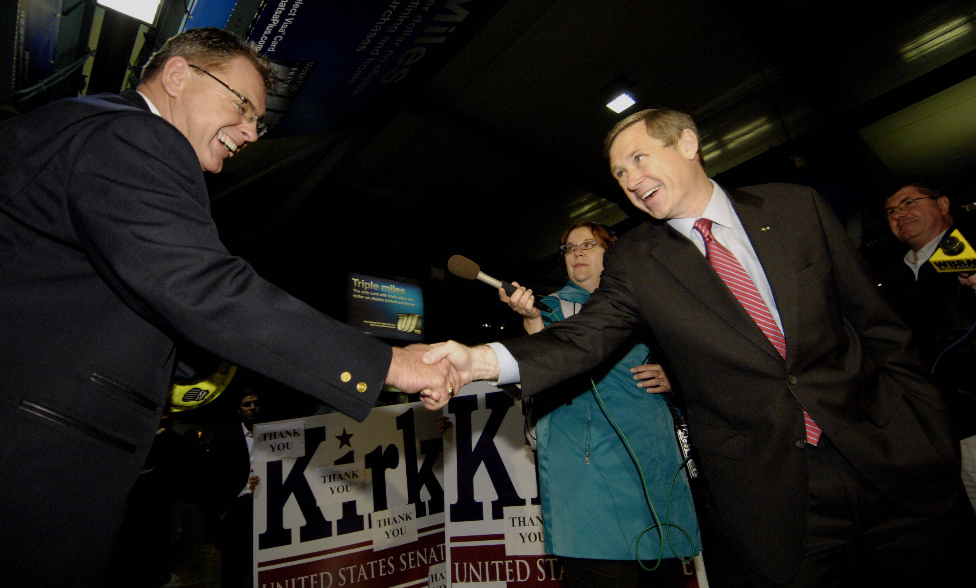 U.S. Senator-elect Mark Kirk greets commuters at the Ogilvie Transportation Center in Chicago.