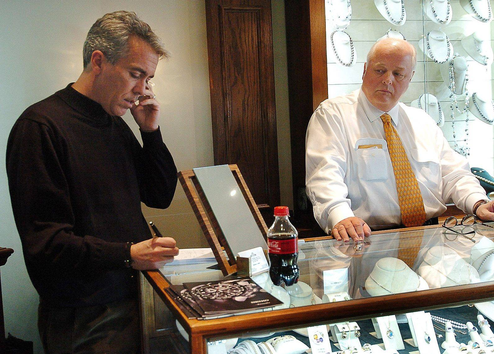 8th District candidate Joe Walsh works out of a makeshift office provided by M.J. Miller & Co. in Barrington on the day after the election. Here, Walsh is pictured with business owner Michael J. Miller.