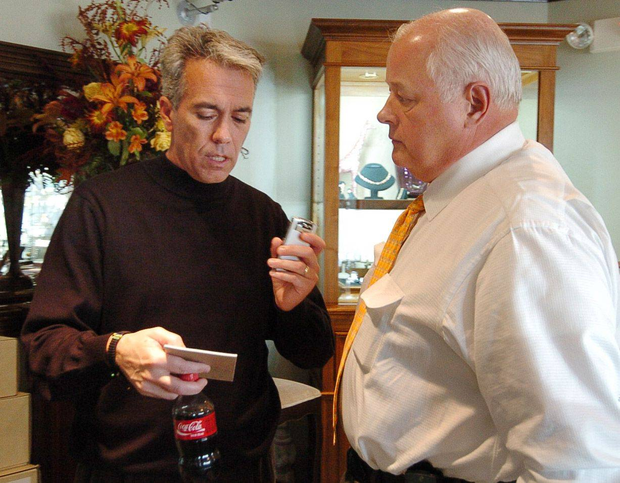 8th District candidate Joe Walsh works out of a makeshift office provided by M.J. Miller & Co. in Barrington on the day after the election. Here with owner Michael J. Miller.