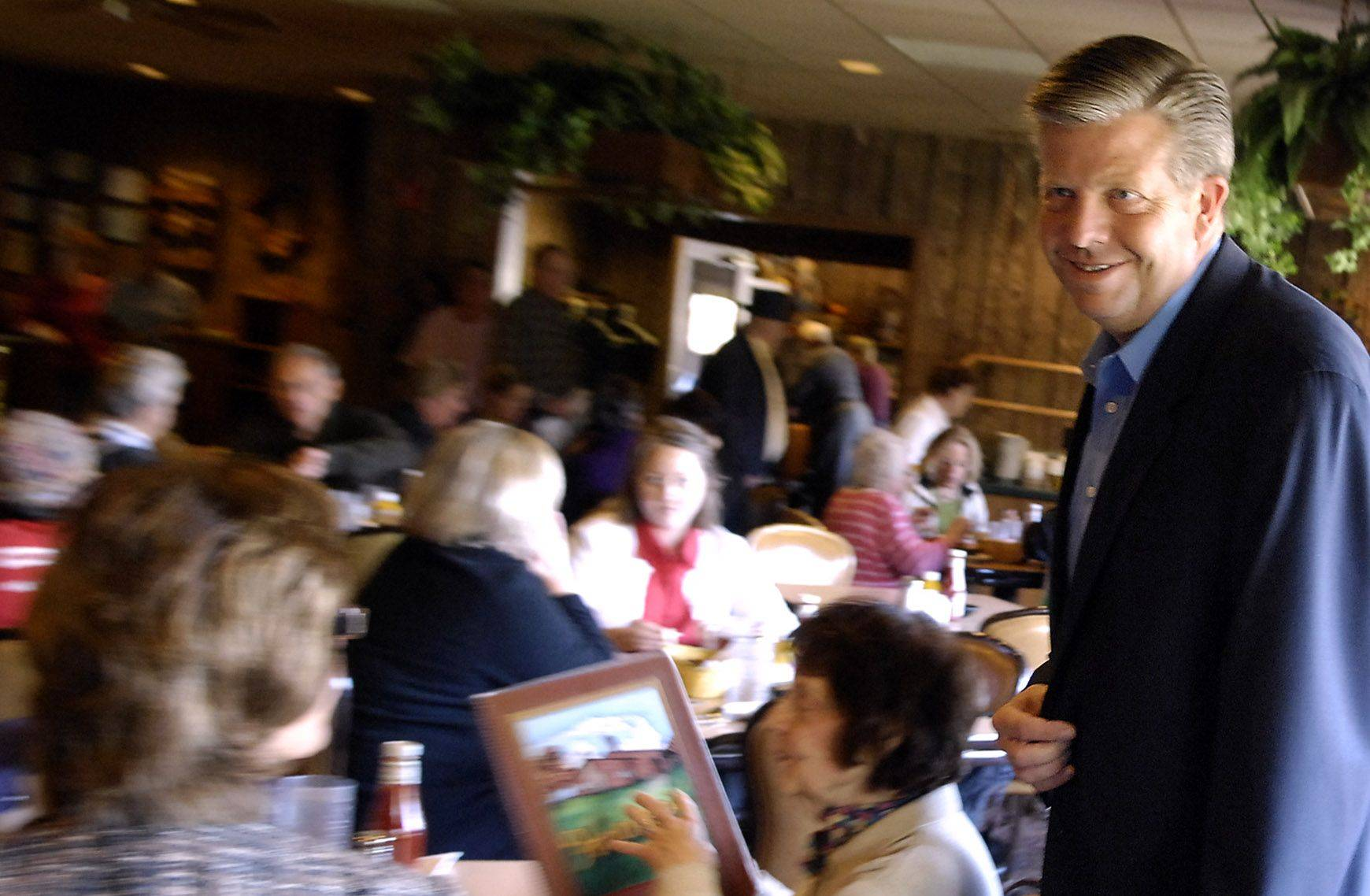 Congressman-elect Randy Hultgren mingles with diners before eating lunch at Harner's Bakery and Restaurant in North Aurora Wednesday.