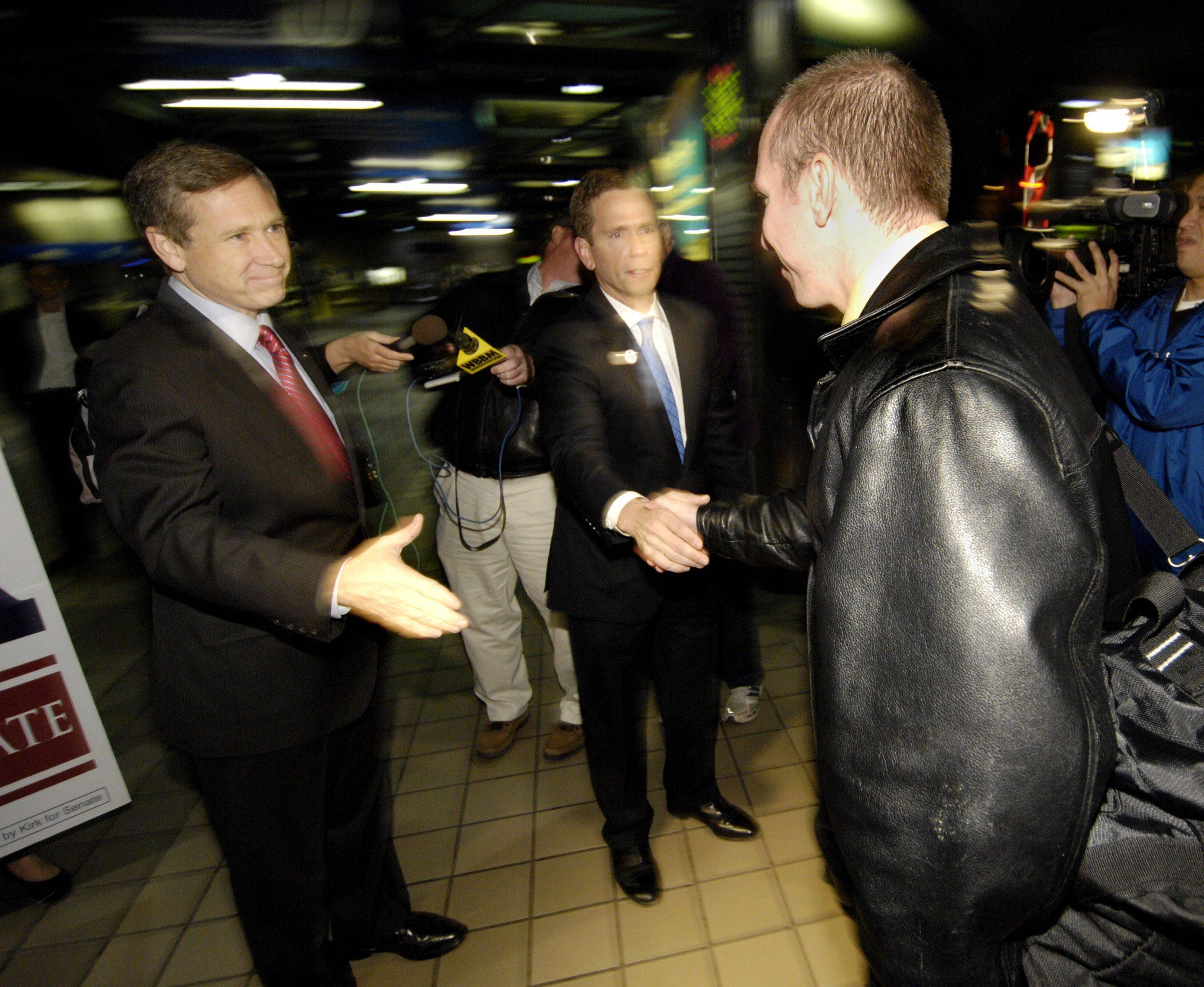 U.S. Senator-elect Mark Kirk and Congressman-elect Robert Dold greet commuters at the Ogilvie Transportation Center in Chicago.
