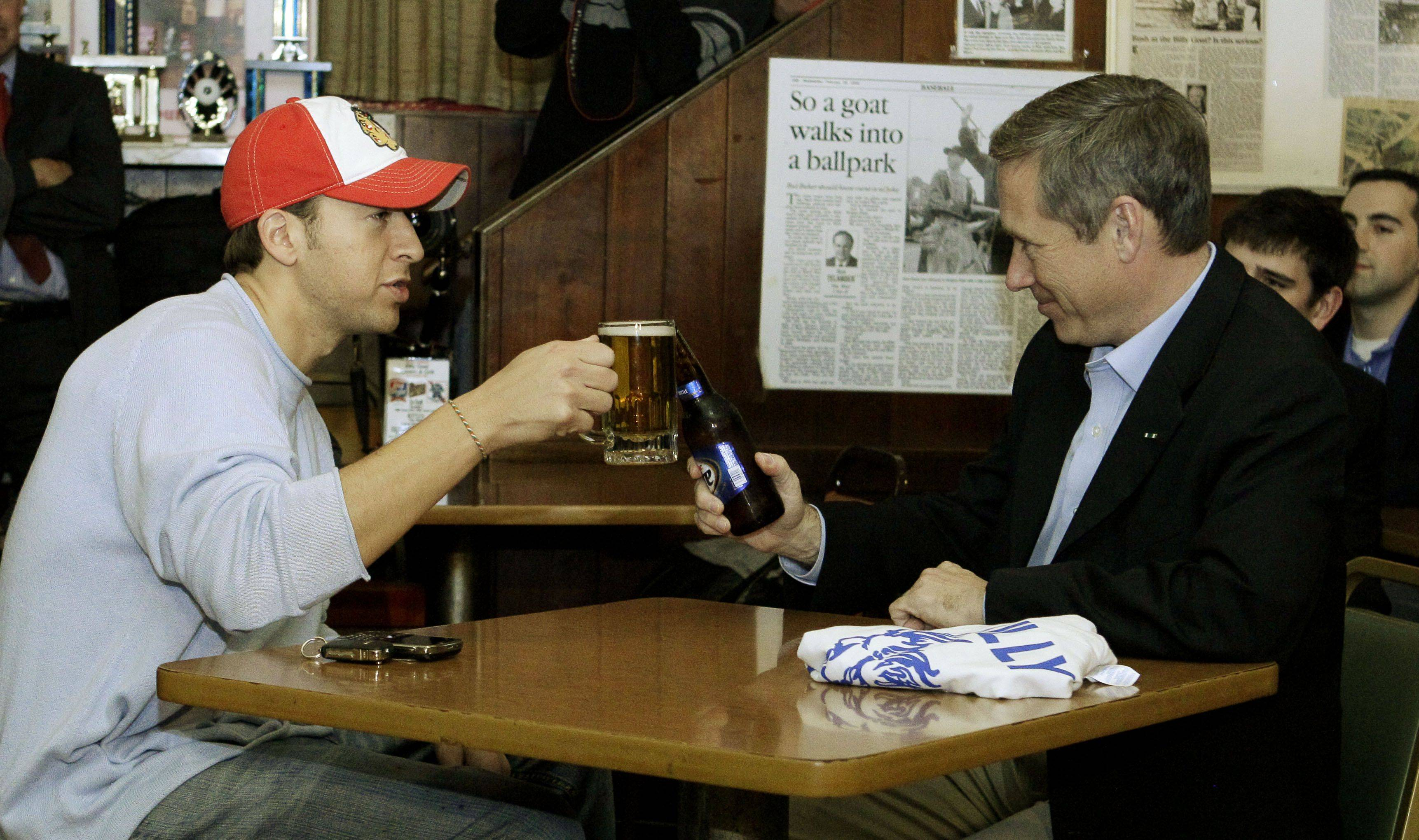 U.S. Senator-elect, Republican Mark Kirk, right, and his Democratic opponent Alexi Giannoulias toast while having a beer at the famed Billy Goat Tavern .