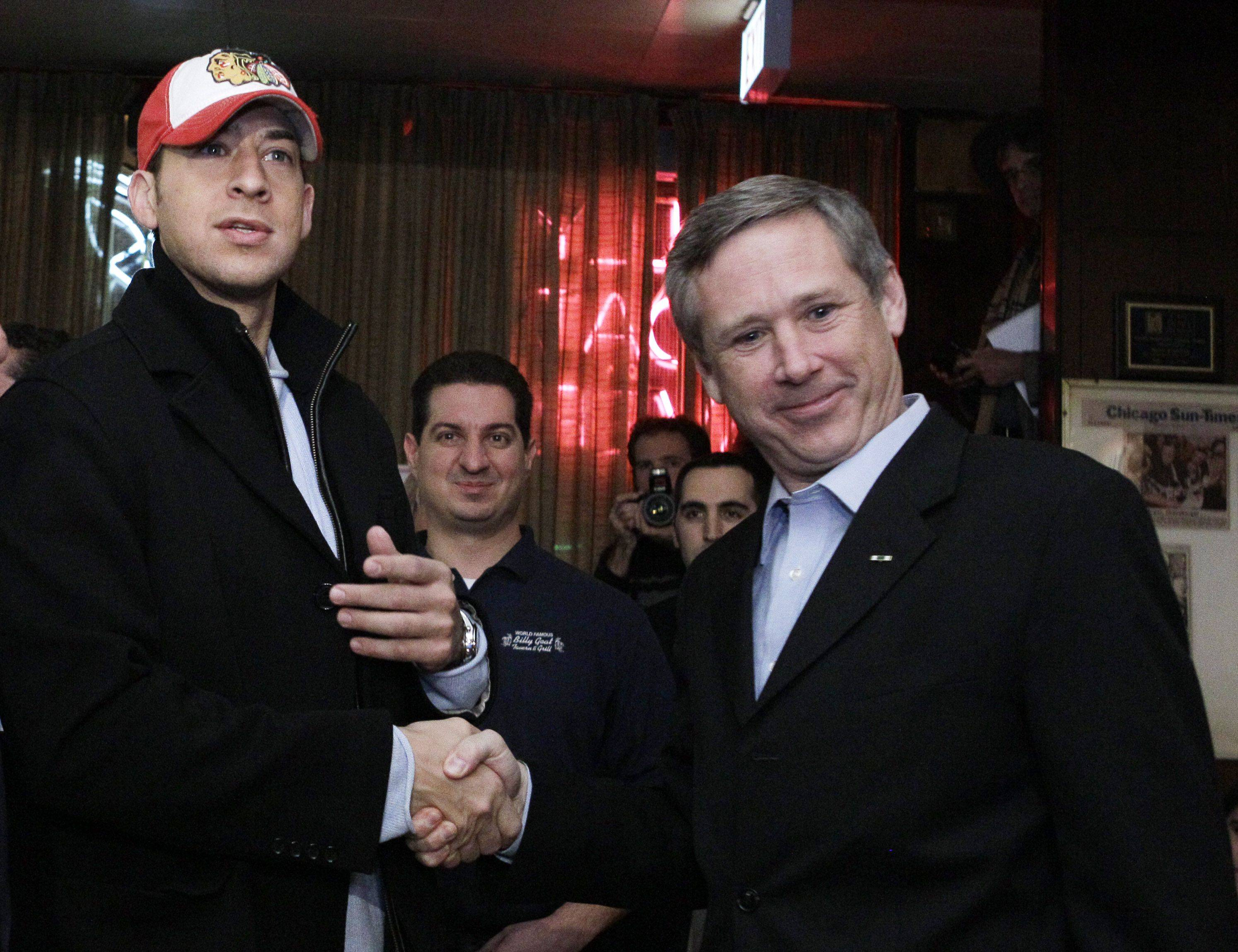 U.S. Senator-elect Republican Mark Kirk, right, and his Democratic opponent Alexi Giannoulias, have a beer at the famed Billy Goat Tavern Wednesday.