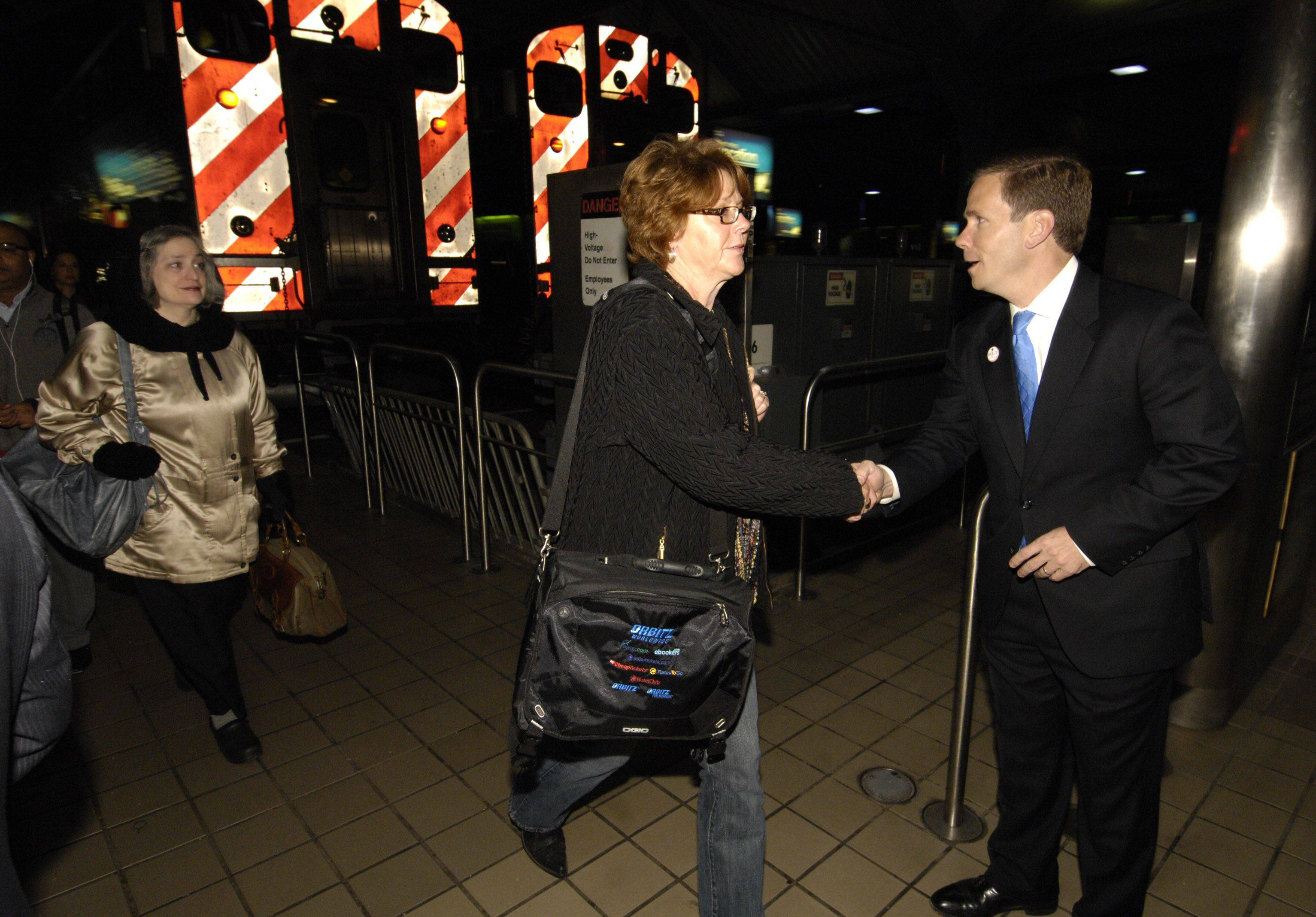 Robert Dold, 10th District congressman-elect, greeted commuters in Chicago Wednesday morning.