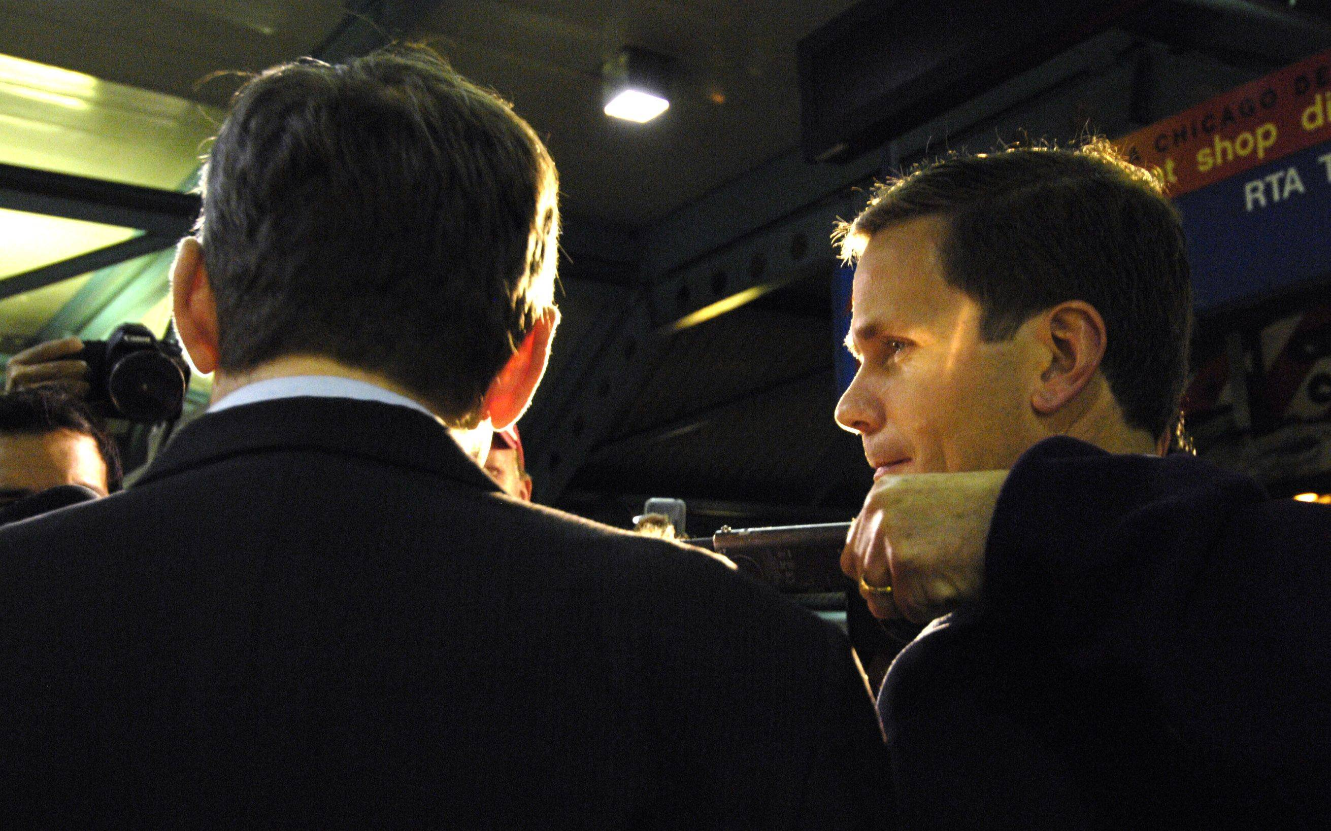 Congressman-elect Robert Dold, right, talks to the media before greeting commuters at the Ogilvie Transportation Center in Chicago Wednesday morning.