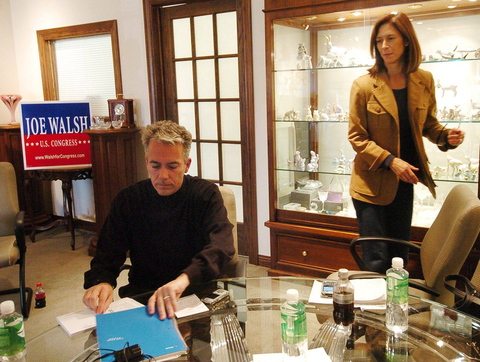 8th District candidate Joe Walsh working out of a makeshift office provided by M.J. Miller & Co. in Barrington on the day after the election with his wife Helene.
