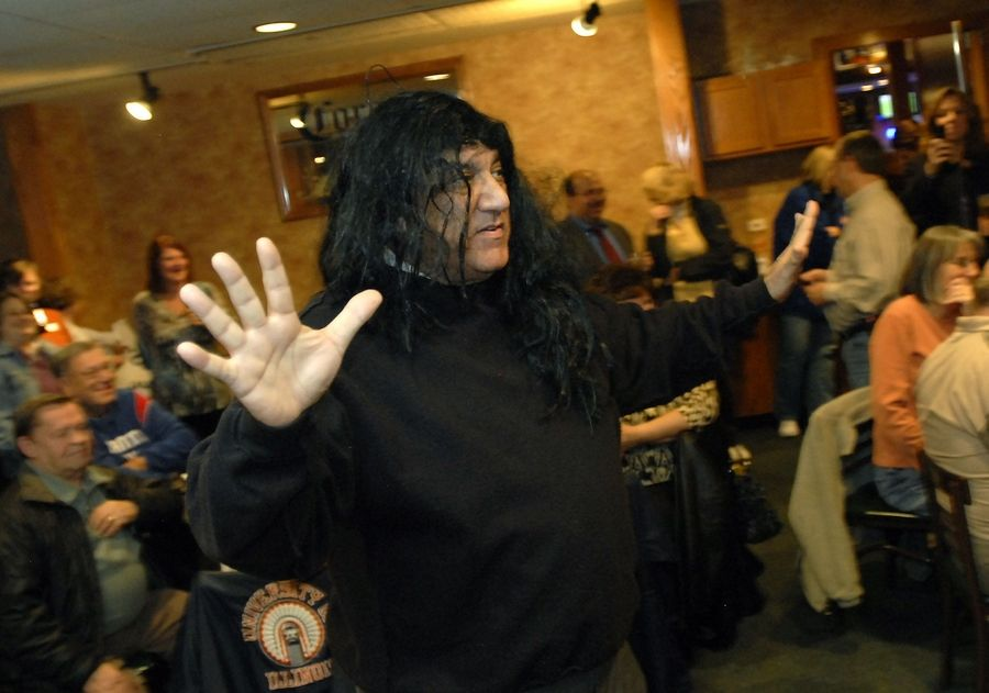 Buffalo Grove Village President Elliott Hartstein performs a parody of ousted village trustee Lisa Stone Tuesday night at a rally for supporters of the controversial official's recall.